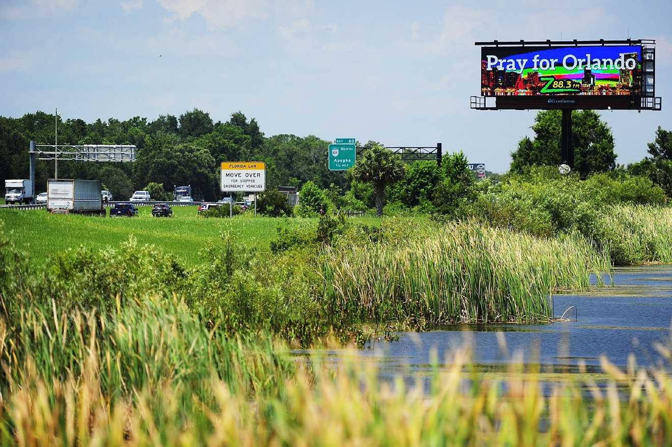 A sign reflects a message of unity Wednesday, June 15, 2016 on Interstate 4 northbound, just south of exit 60, in Orlando. The city and nation is still feeling the effects of the June 12 mass shooting in an Orlando nightclub Â? Pulse. (Corey Perrine/Naples Daily News via AP)
