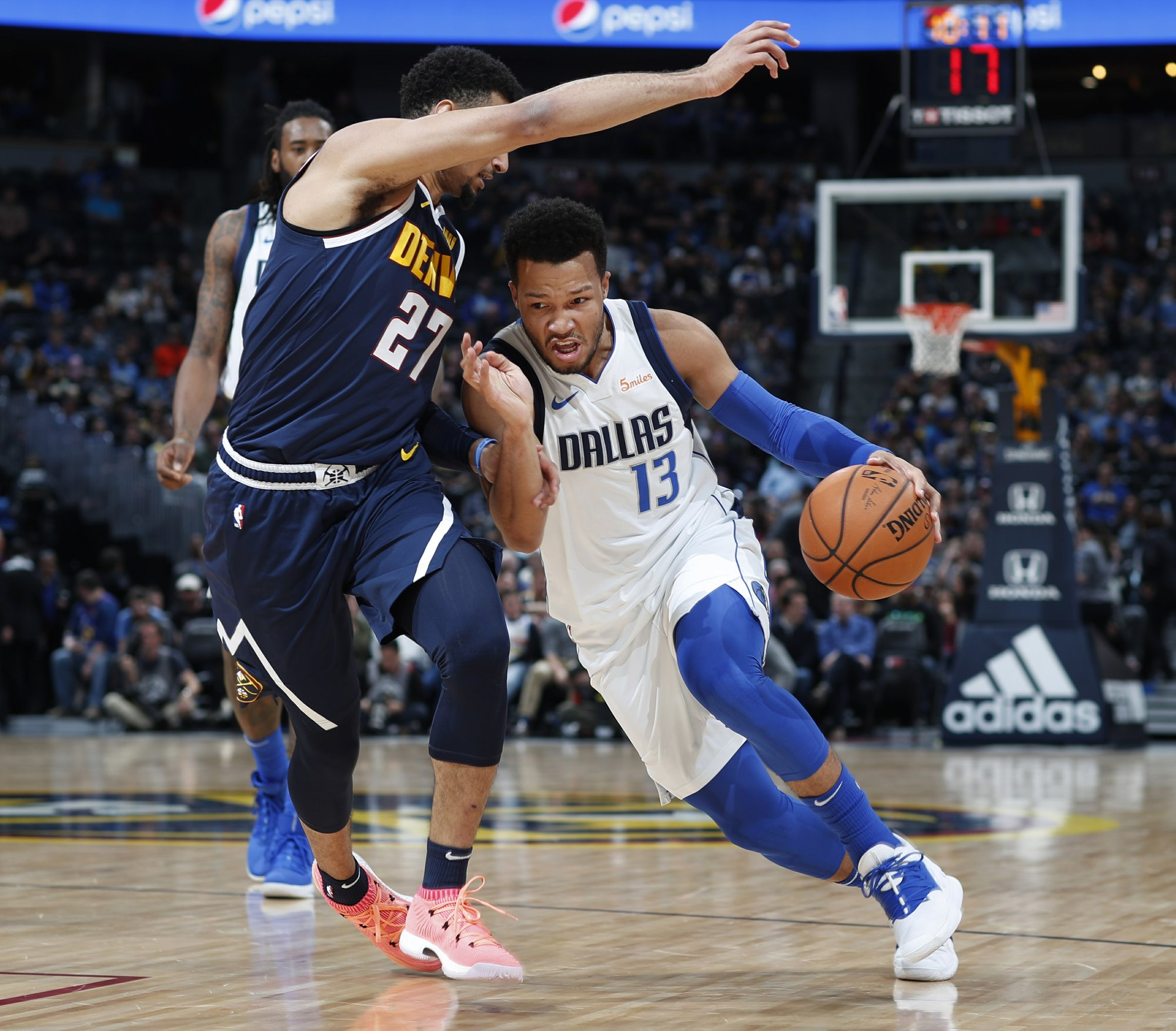 Dallas Mavericks guard Jalen Brunson, right, drives past Denver Nuggets guard Jamal Murray in the first half of an NBA basketball game Tuesday, Dec. 18, 2018, in Denver. (AP Photo/David Zalubowski)
