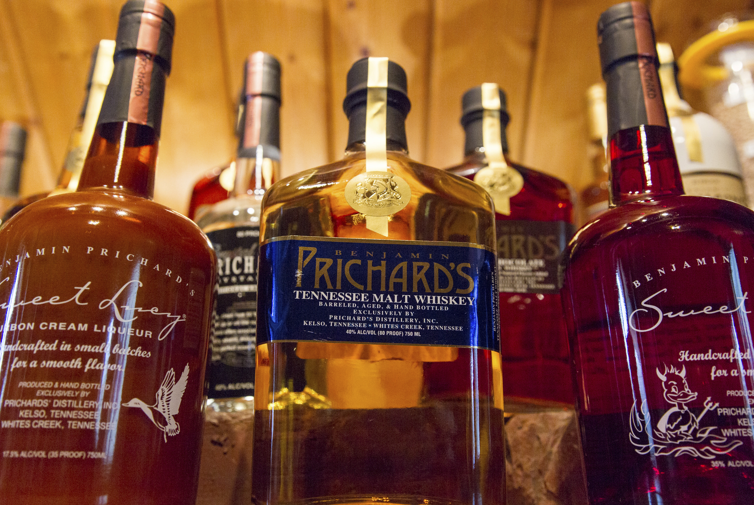 FILE - In this March 19, 2015 file photo, bottles of spirits are on display at the Prichard's Distillery in Nashville, Tenn. A spirits industry trade group says the tariff-induced hangover for American whiskey producers became more painful in late 2018. (AP Photo/Erik Schelzig)