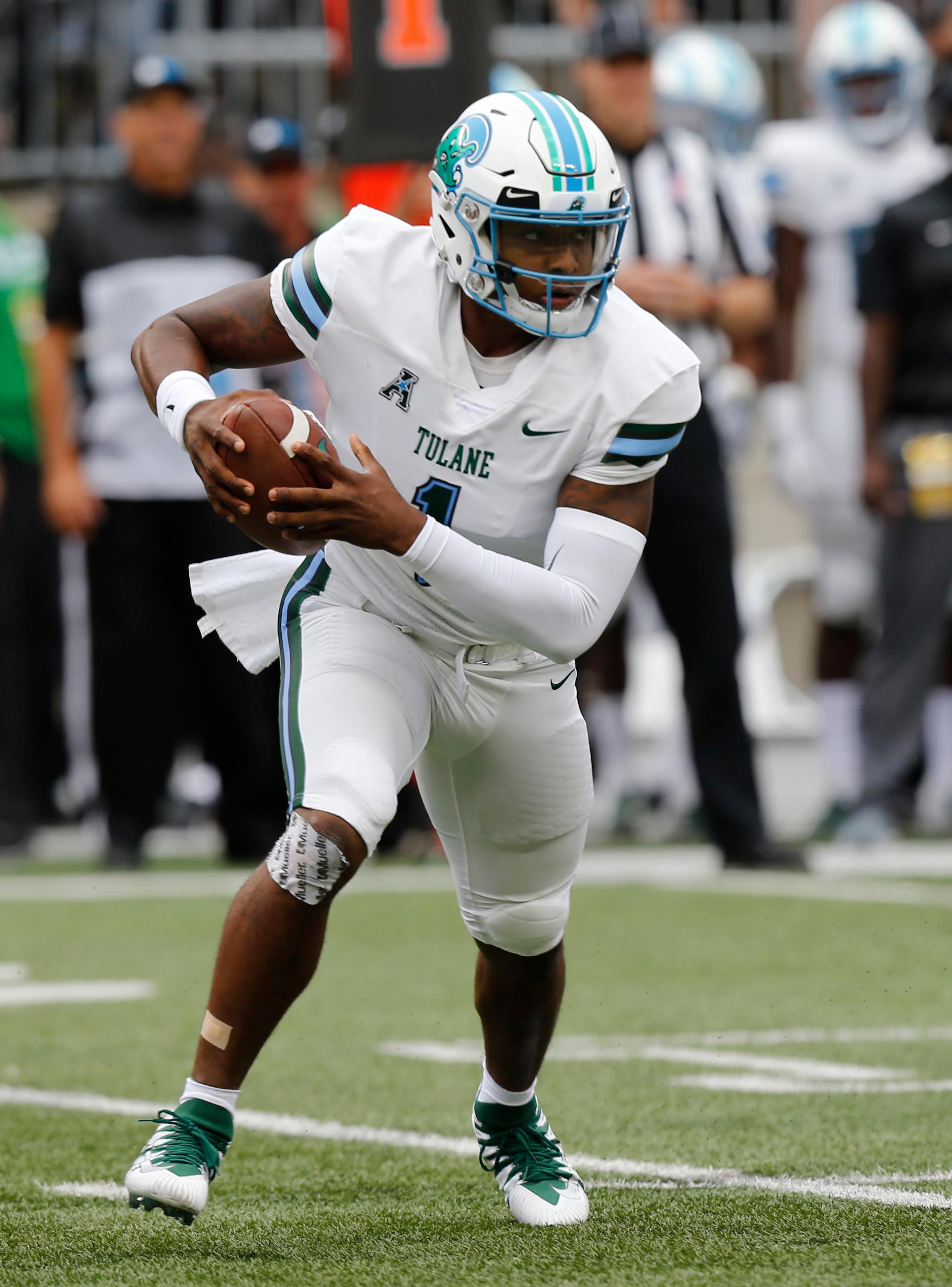 Tulane quarterback Jonathan Banks looks for an opening to run through against Ohio State during the first half of an NCAA college football game Saturday, Sept. 22, 2018, in Columbus, Ohio. (AP Photo/Jay LaPrete)