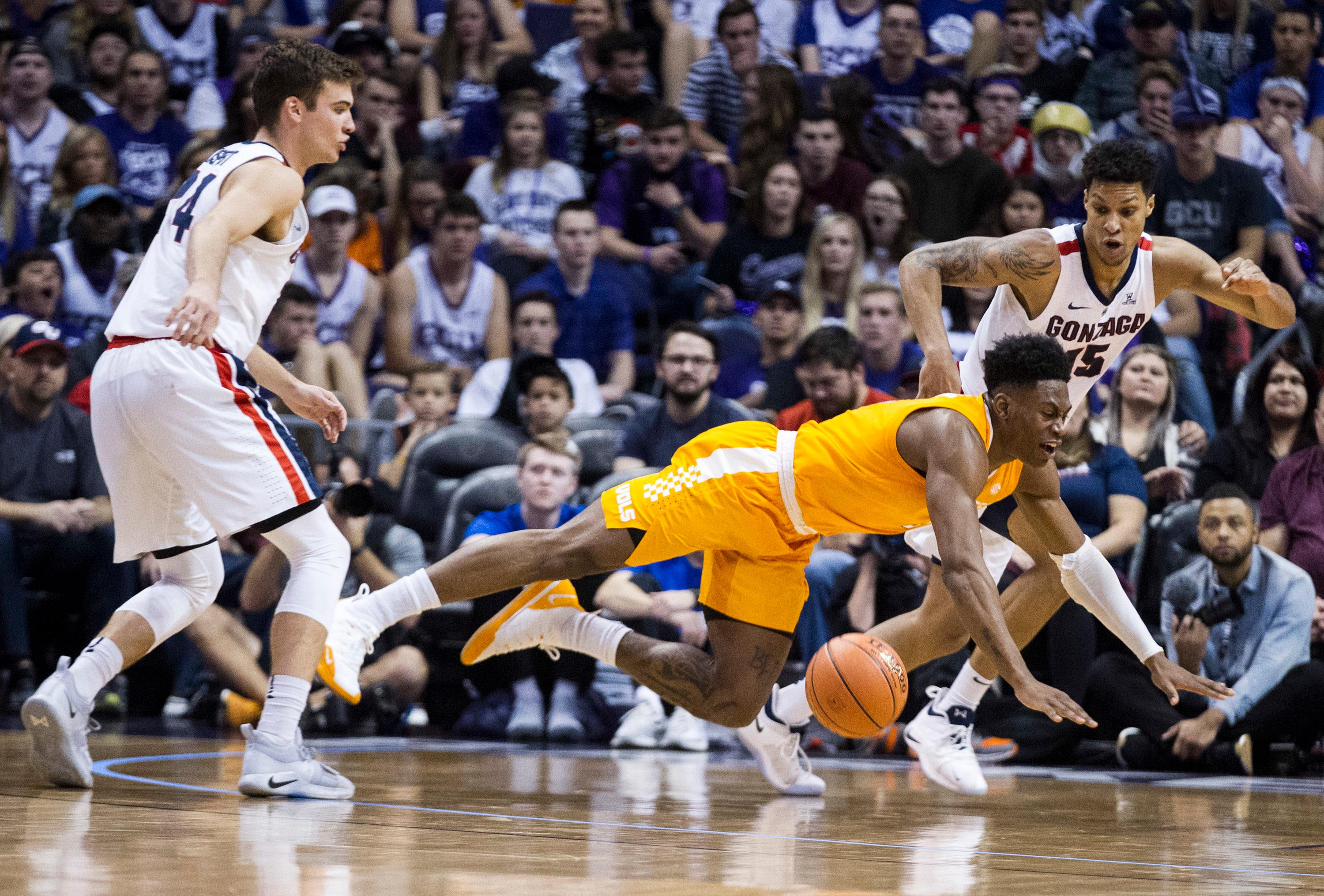 Tennessee's Admiral Schofield (5) loses the ball against Gonzaga's Corey Kispert (24) and Brandon Clarke (15) during the first half of an NCAA college basketball game Sunday, Dec. 9, 2018, in Phoenix. (AP Photo/Darryl Webb)