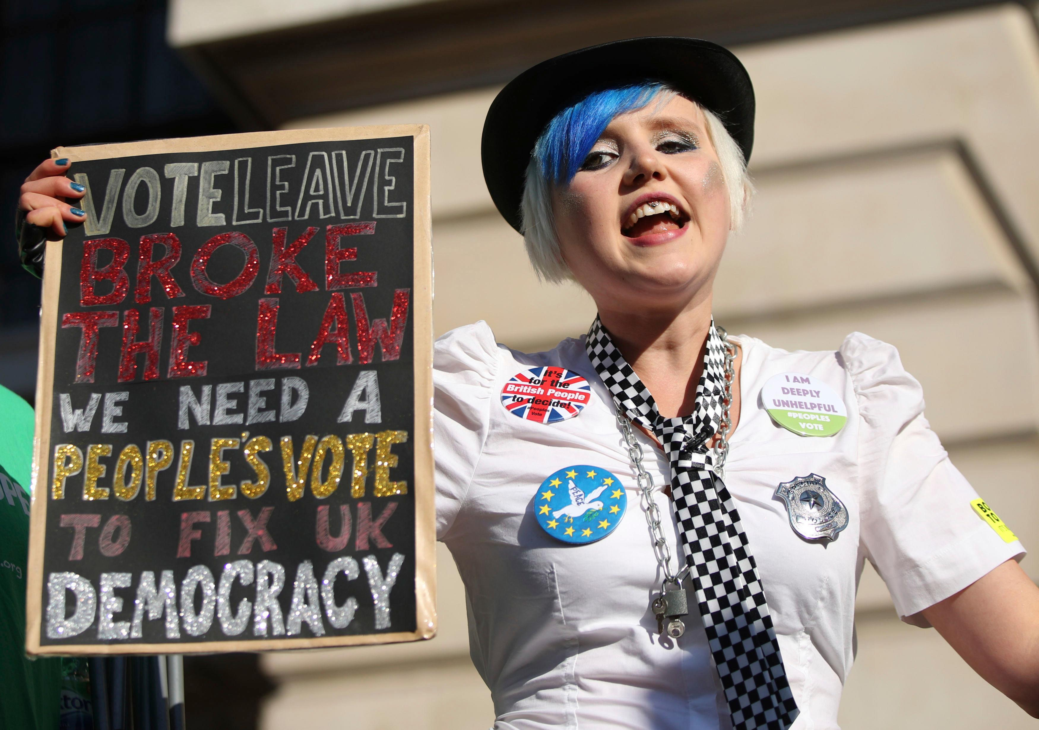 An anti-Brexit campaigners take part in the People's Vote March for the Future in London, a march and rally in support of a second EU referendum, in London, Saturday Oct. 20, 2018. (Yui Mok/PA via AP)