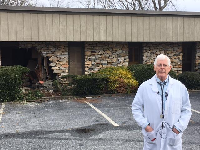 Dr. David Slawek outside of his office on Jan. 3, 2018, after a car crashed though the side of the building. (Photo credit: WLOS Staff)