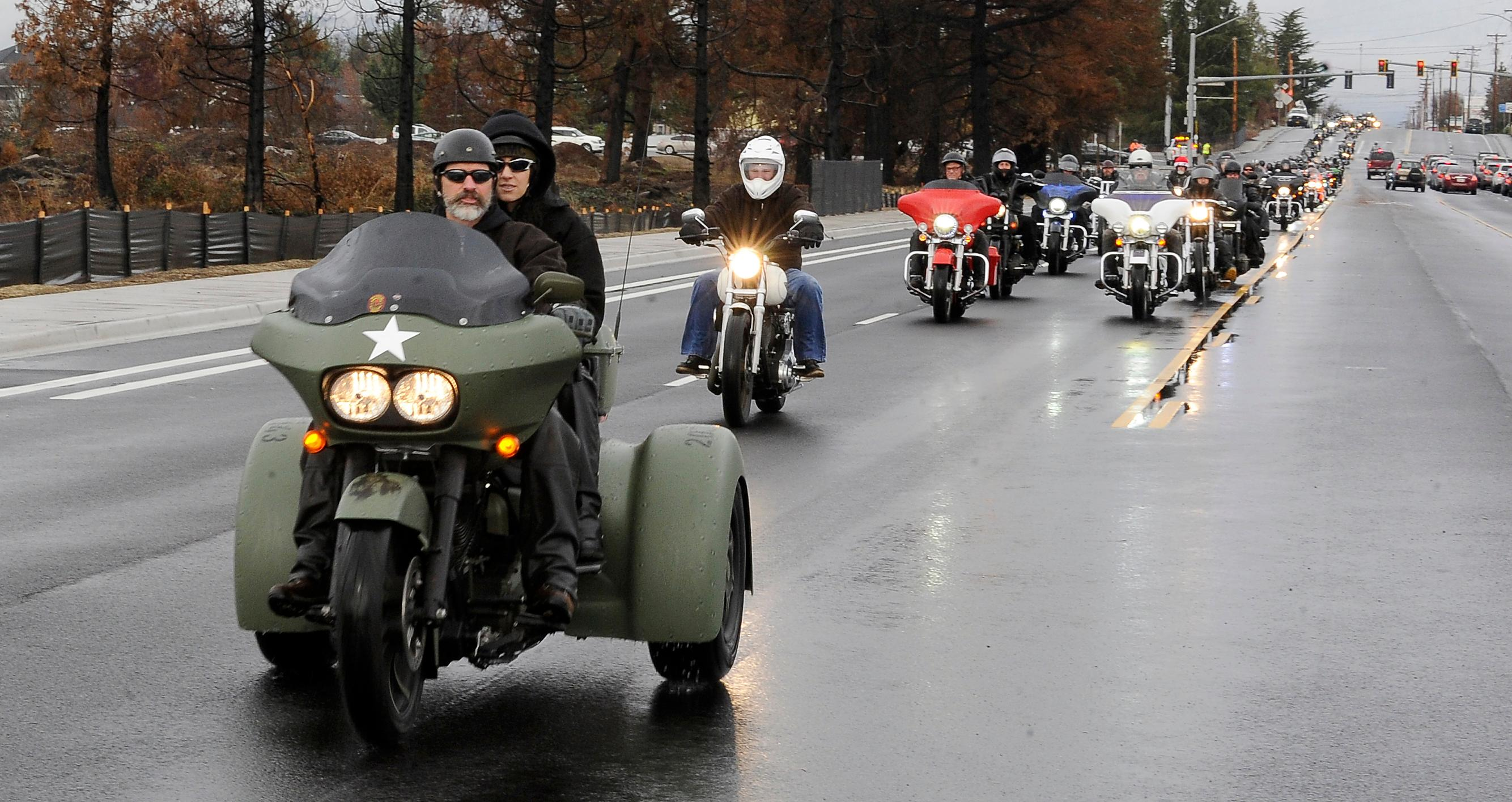 Andy Atkinson / Mail Tribune <br><p>Motorcycles travel down Table Rock Road in Central Point Saturday during the Southern Oregon Toy Run.</p>