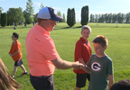 first tee shaking hands.png