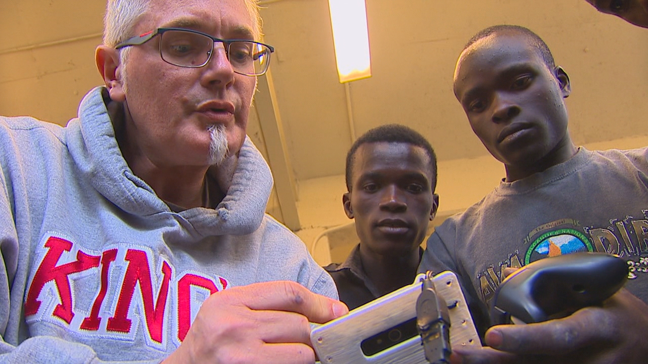The King's High School CyberKnights are mentoring students who were once child soldiers in Uganda, to compete in a robotics competition. (Photo: KOMO News)