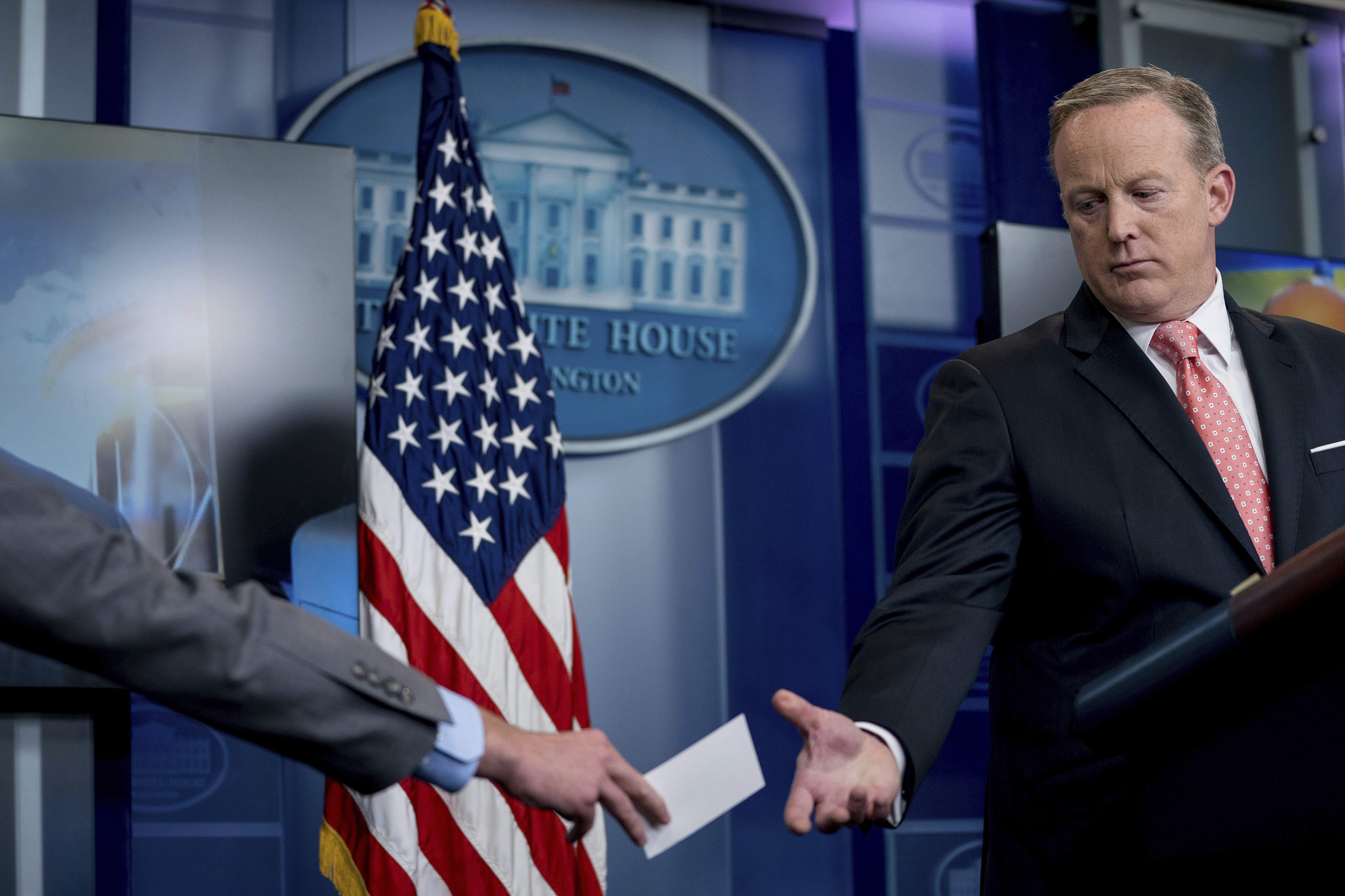 White House press secretary Sean Spicer gets a note from a staff member during the daily press briefing at the White House, Tuesday, June 6, 2017, in Washington. Spicer discussed Trump's tweets, former FBI Director James Comey's congressional testimony and other topics. (AP Photo/Andrew Harnik)