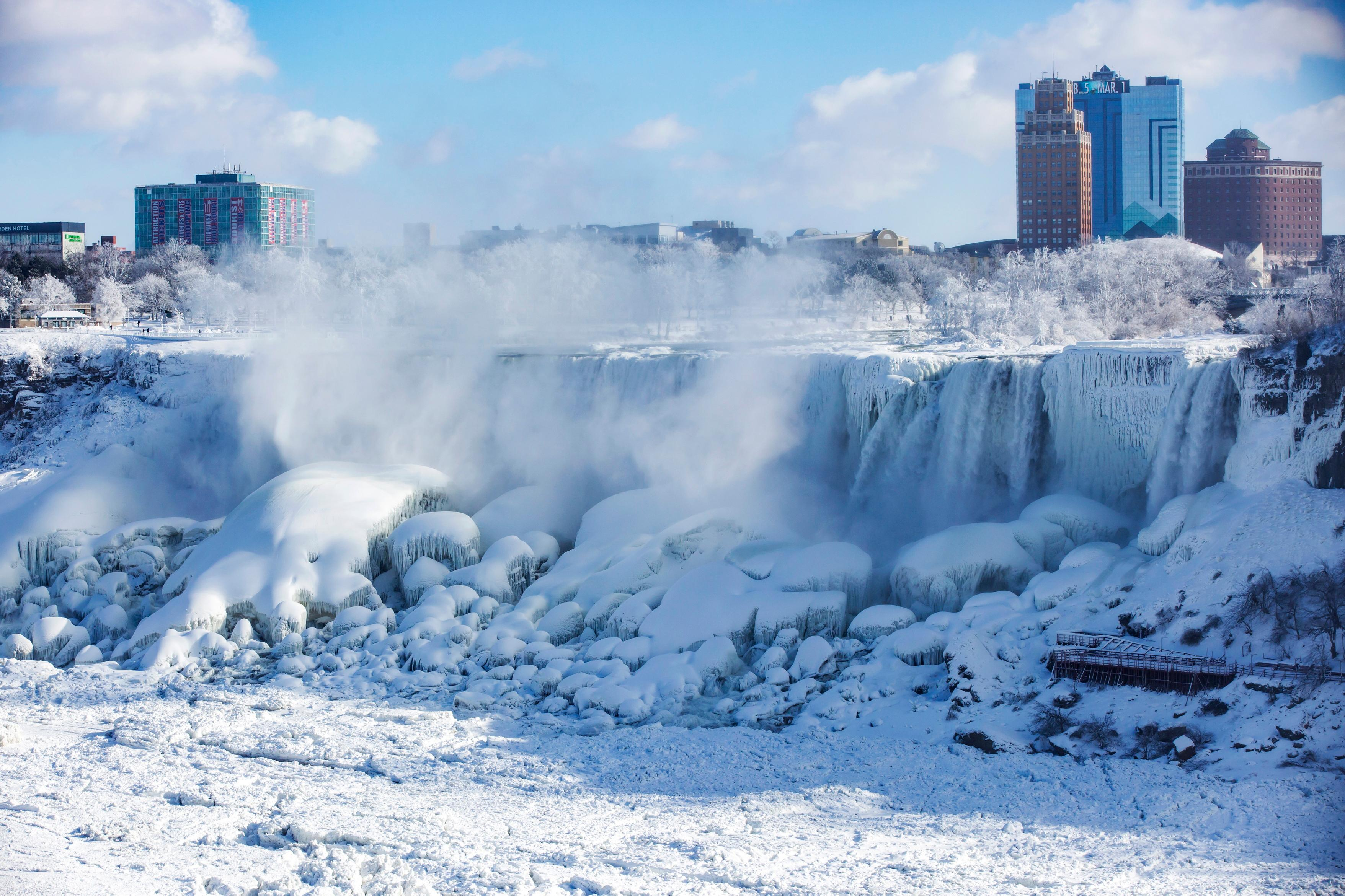 Ice and water flows over the American Falls, seen from Niagara Falls, Ontario, Canada Thursday, Jan. 31, 2019.  (Tara Walton/The Canadian Press via AP)