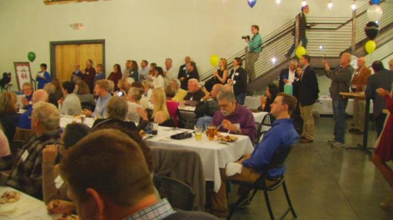 The crowd at Highlands Brewing Company listens to speakers at UNCA's Baseball Night (WLOS Staff).jpg