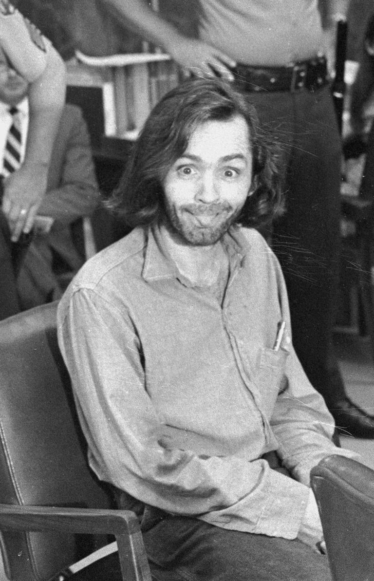 FILE - In this June 25, 1970 file photo, Charles Manson sticks his tongue out at photographers as he appears in a Santa Monica, Calif., courtroom, charged with the slaying of musician Gary Hinman.{&amp;nbsp;} (AP Photo, File)<p></p>