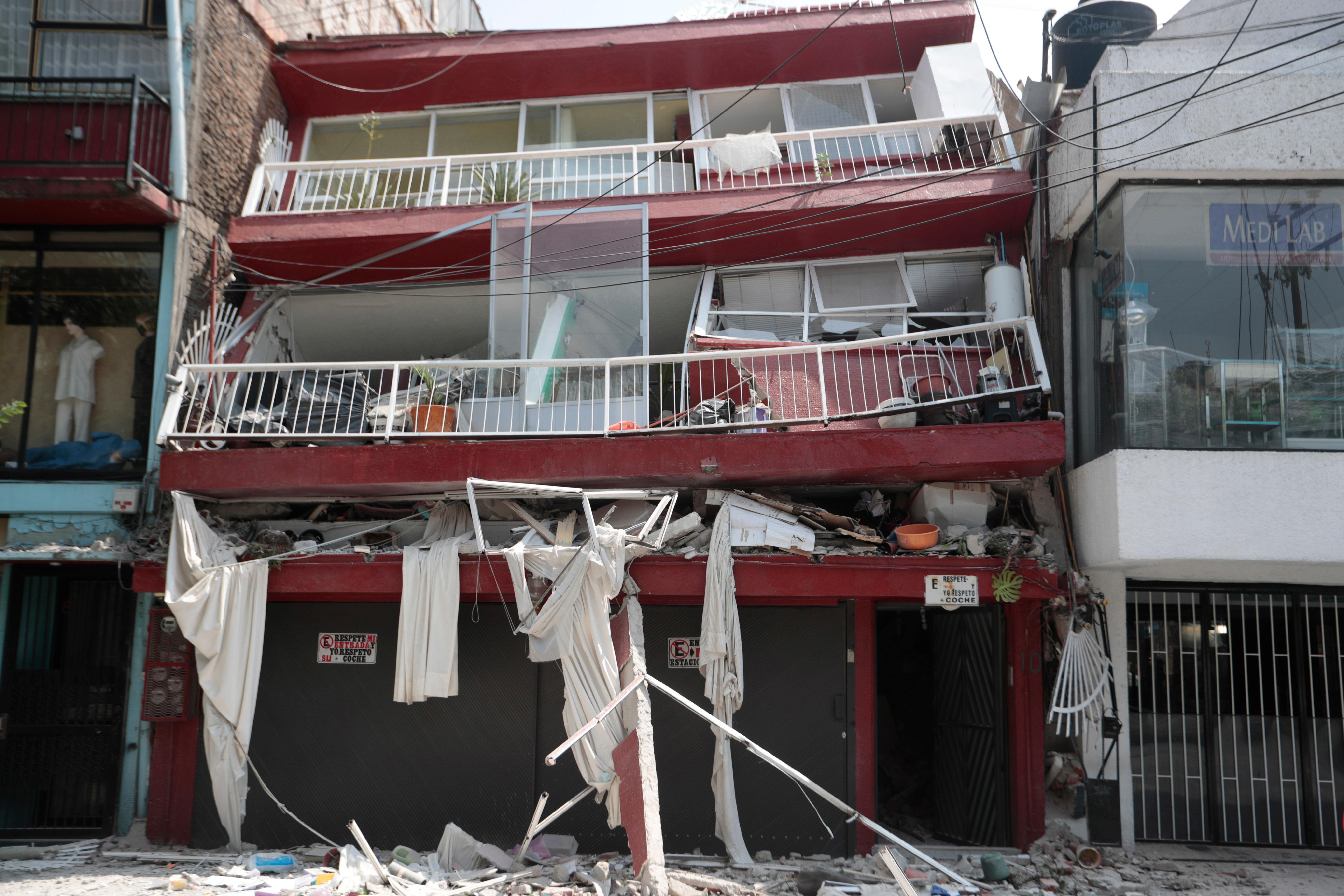 A heavily damaged building stands after an earthquake in the Narvarte neighborhood of Mexico City, Tuesday, Sept. 19, 2017. A magnitude 7.1 earthquake has rocked central Mexico, killing at least 55 people as buildings collapsed in plumes of dust and thousands fled into the streets in panic. (AP Photo/Eduardo Verdugo)
