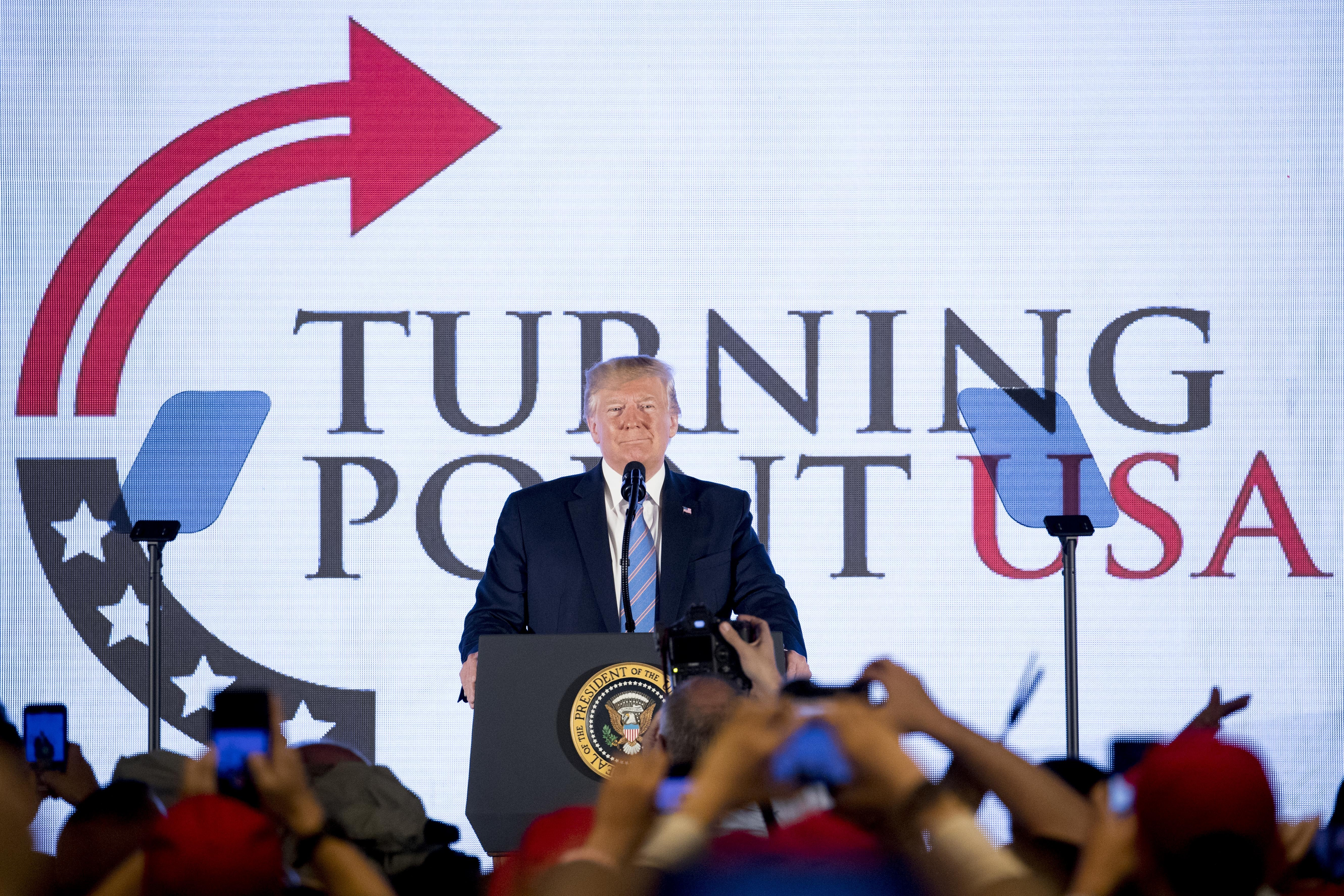 President Donald Trump takes the stage at Turning Point USA Teen Student Action Summit at the Marriott Marquis in Washington, Tuesday, July 23, 2019. (AP Photo/Andrew Harnik)