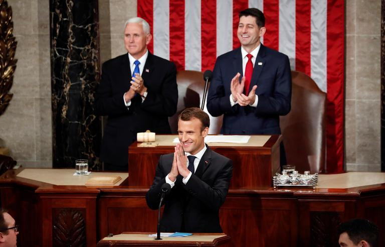 French President Emmanuel Macron gestures as he is introduced before speaking to a joint meeting of Congress on Capitol Hill in Washington, Wednesday, April 25, 2018. Standing behind him are Vice President Mike Pence and House Speaker Paul Ryan of Wis., (AP Photo/Pablo Martinez Monsivais)
