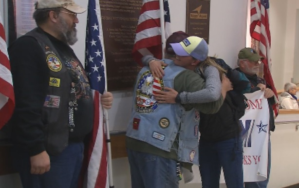 Lt. Nicki Warner embraces the West Virginia Patriot Guard Riders after flying into Charleston from Bahgram Air Force Base in Afghanistan. (WCHS/WVAH)