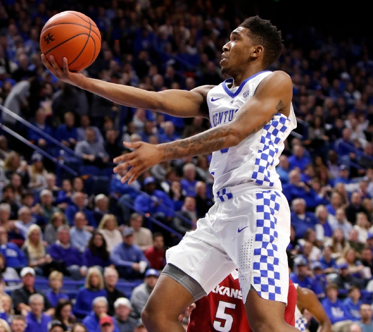 FILE - In this Jan. 7, 2017, file photo, Kentucky's Malik Monk shoots against Arkansas during the second half of an NCAA college basketball game, in Lexington, Ky. Kentucky freshman Malik Monk was picked as both player and newcomer of the year, while Florida's Mike White claimed the coaching award on the All-Southeastern Conference men's basketball team announced Tuesday, March 7, 2017,  by The Associated Press. (AP Photo/James Crisp, Fle)