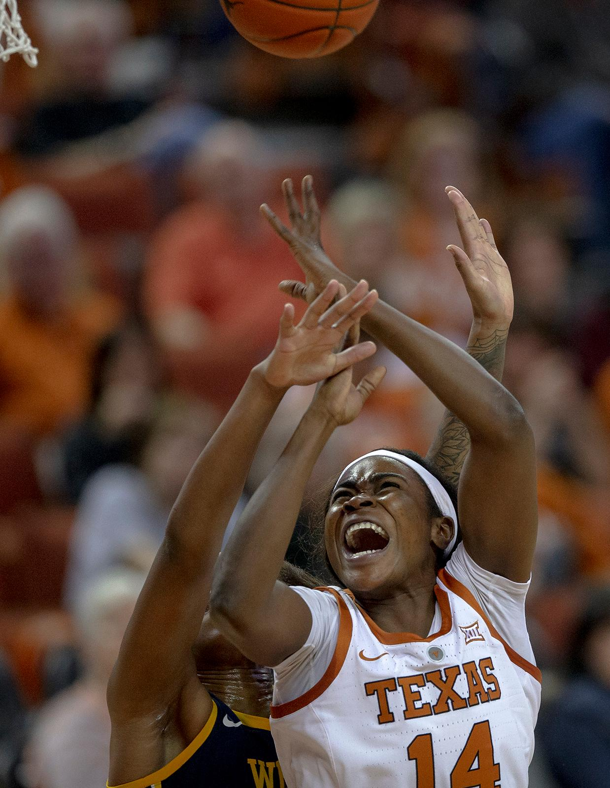 Texas forward Olamide Aborowa (14) is fouled while shooting against West Virginia during an NCAA college basketball game on Monday, Jan. 28, 2019, in Austin, Texas. (Nick WagnerAustin American-Statesman via AP)