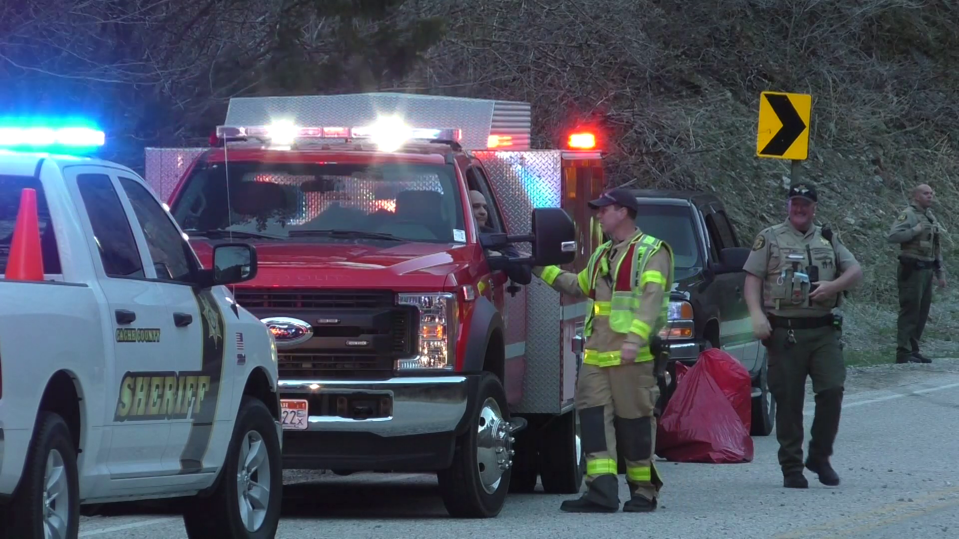 Witnesses rescue two men trapped in upside down truck in Logan River. (Brian Champagne, KUTV)