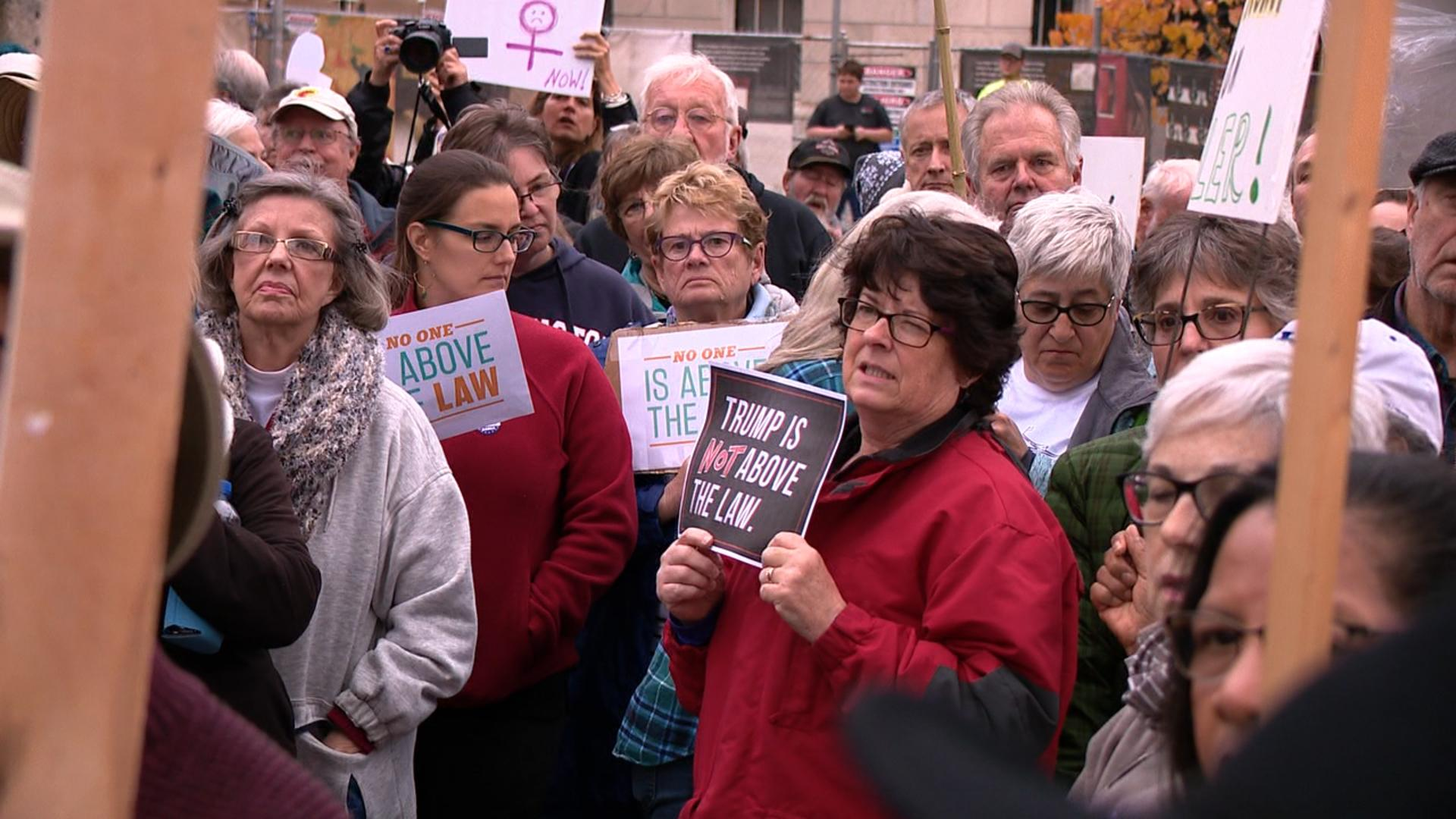 Activists rallied at Vance Monument in downtown Asheville over fears President Trump is derailing Robert Mueller's Russia investigation. (Photo credit: WLOS staff)