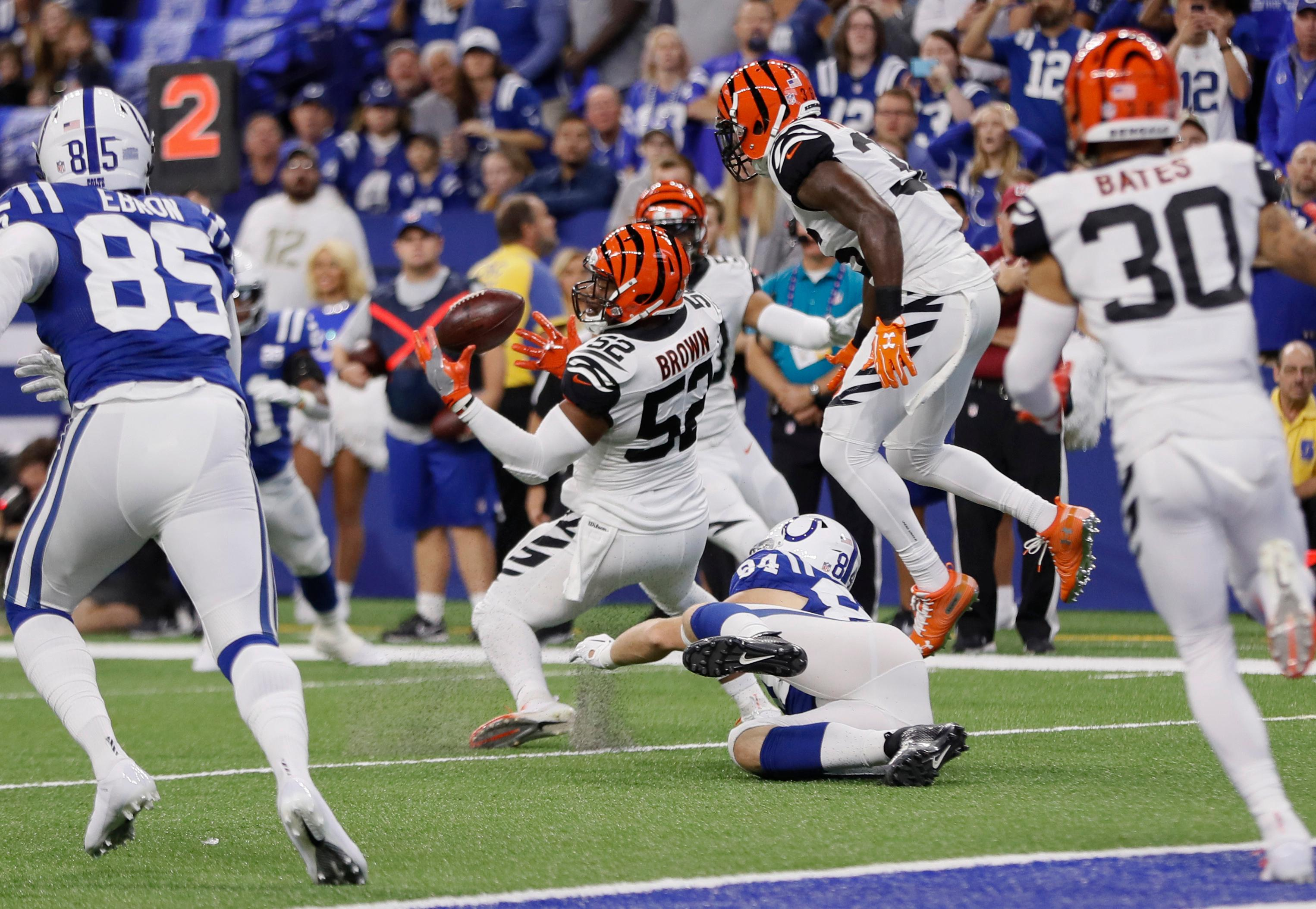 Cincinnati Bengals linebacker Preston Brown (52) intercepts a pass by Indianapolis Colts quarterback Andrew Luck (12) during the first half of an NFL football game in Indianapolis, Sunday, Sept. 9, 2018. (AP Photo/John Minchillo)