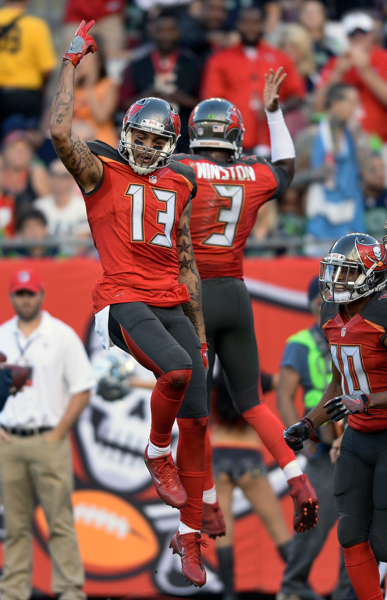Tampa Bay Buccaneers wide receiver Mike Evans (13) celebrates with quarterback Jameis Winston (3) after Evans caught a 23-yard touchdown reception against the Seattle Seahawks during the second quarter of an NFL football game Sunday, Nov. 27, 2016, in Tampa, Fla. (AP Photo/Jason Behnken)