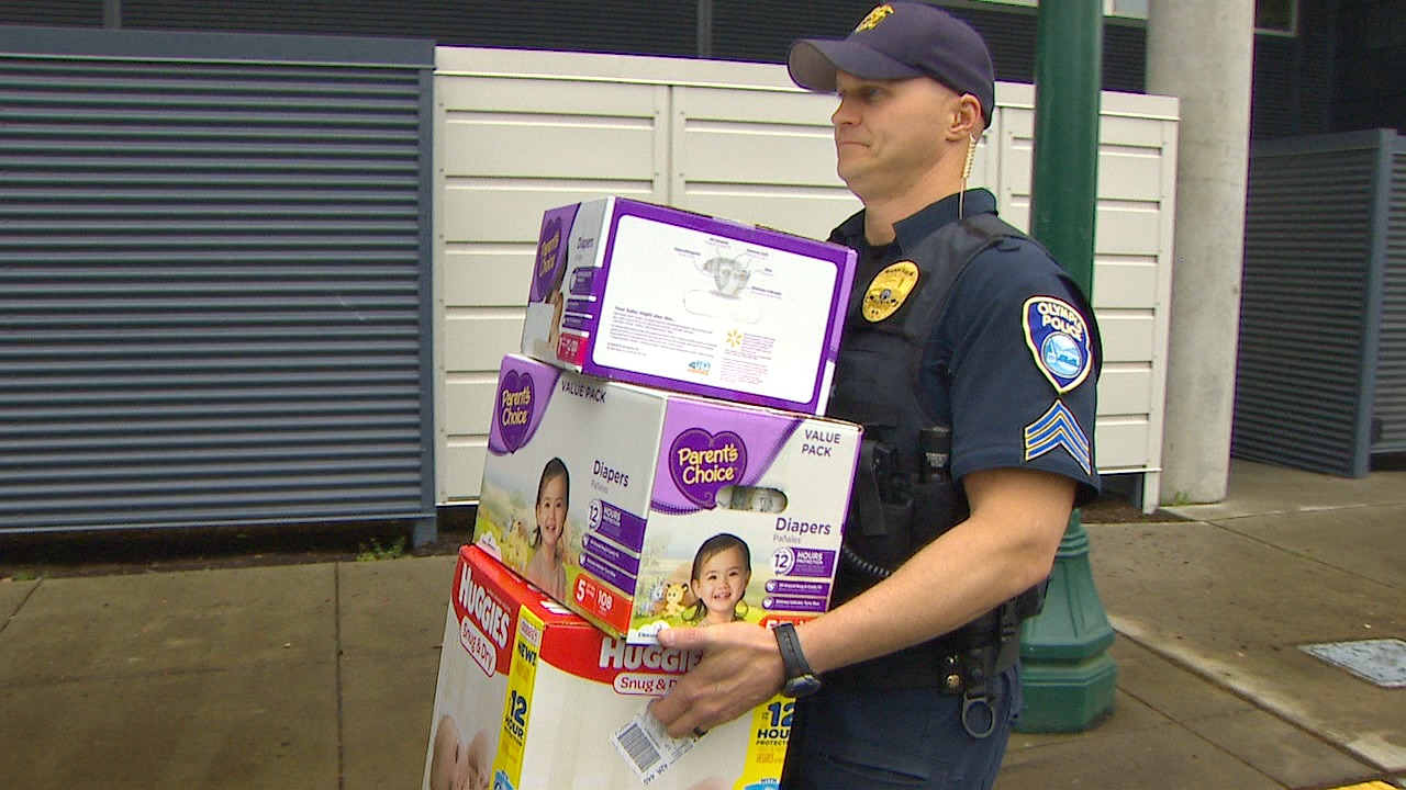 A donation drive by the Olympia Police Department recently brought more than 17,000 diapers to Lance Benson. (Photo: KOMO News)