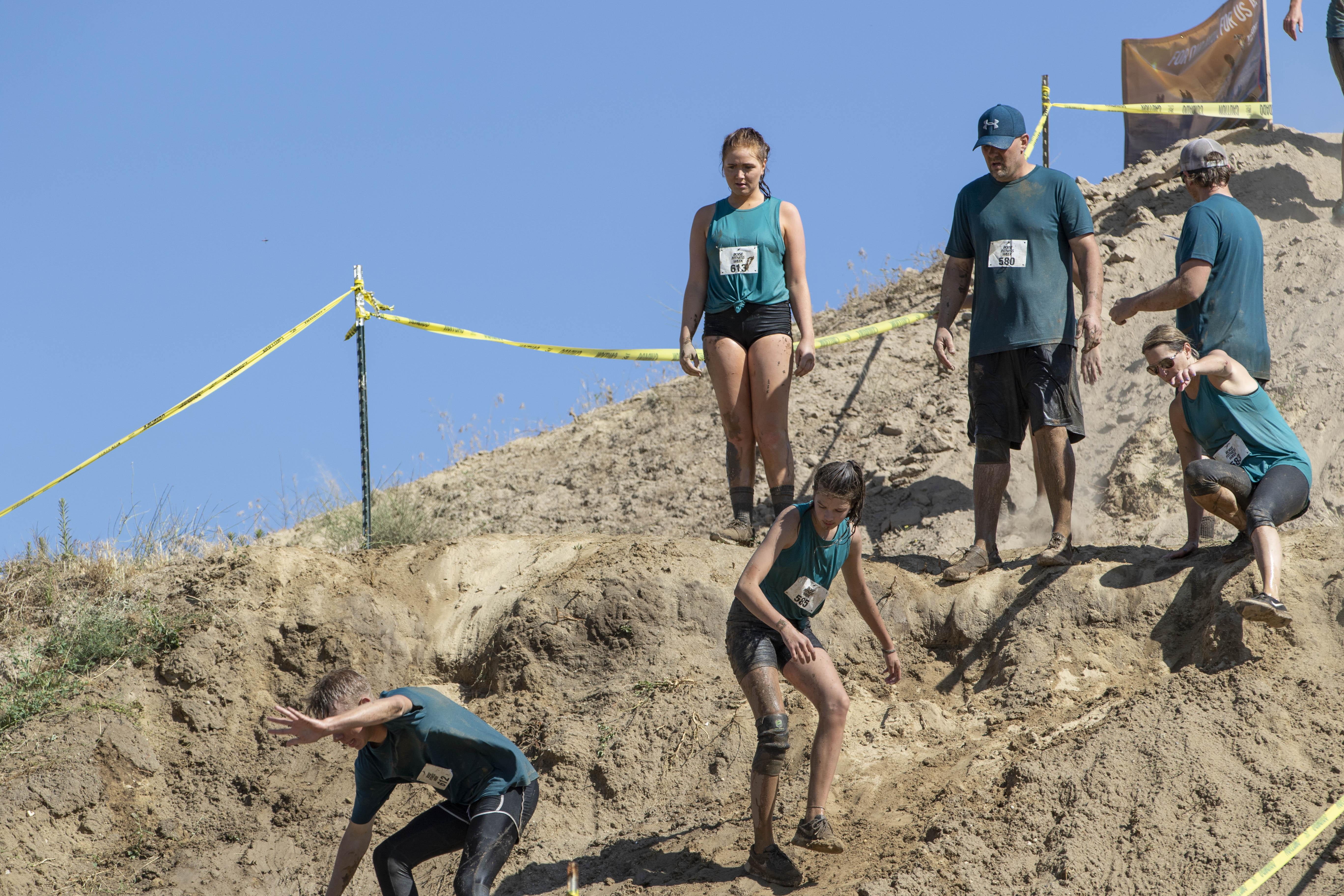 The 6th Annual Tater Dash Mud Run took place at Twin Oaks Farms in Eagle on Saturday, July 20. The run is just over five miles and features many different obstacles such as large mud pits and steep slippery hills. (Photos by Axel Quartarone){ }