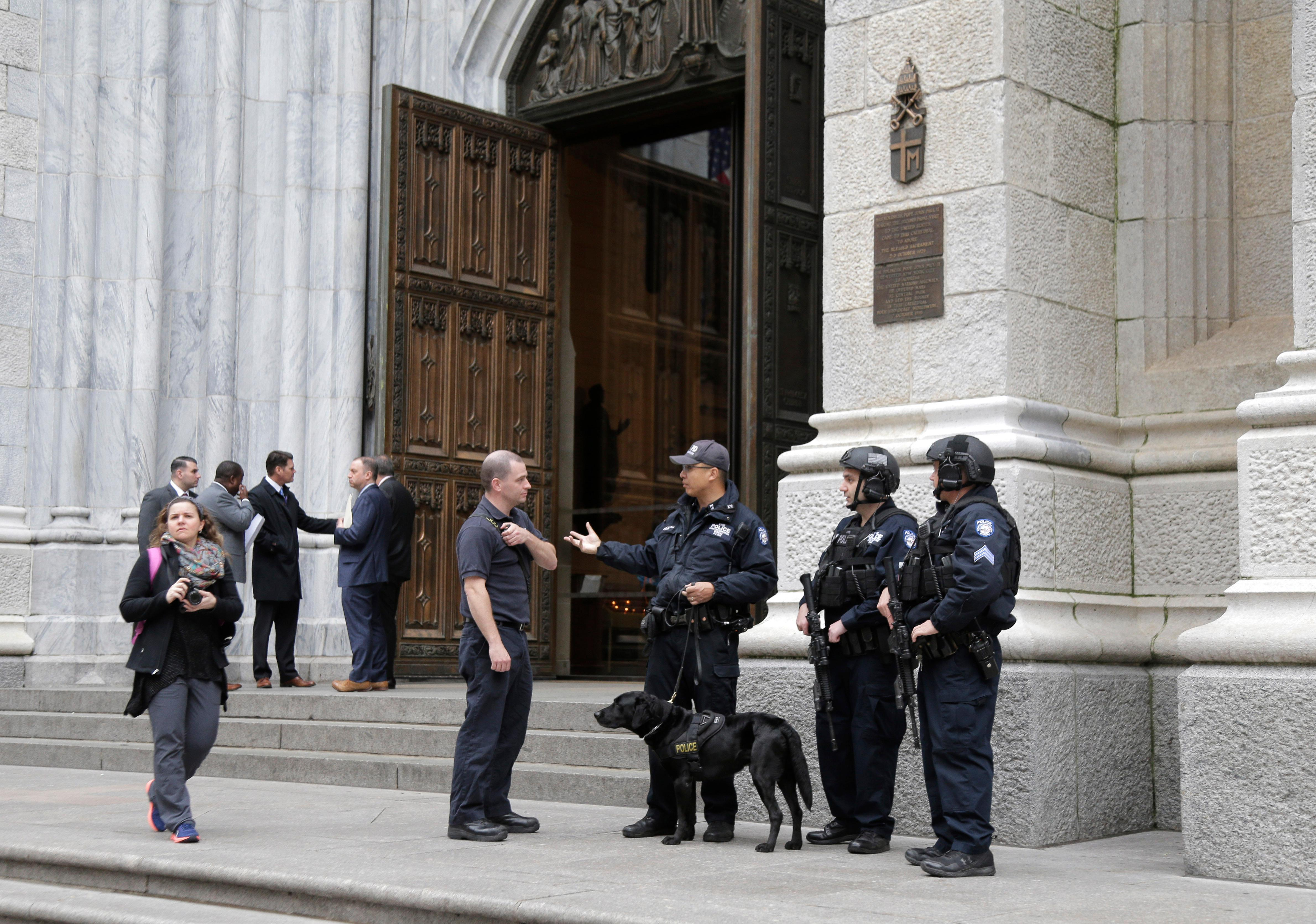 A larger-than-usual security presence is seen at St. Patrick's Cathedral in New York, Thursday, April 18, 2019. A New Jersey man was arrested Wednesday night, after entering the cathedral carrying two cans of gasoline, lighter fluid and butane lighters, the New York Police Department said, just days after flames ravaged the Notre Dame cathedral in Paris. (AP Photo/Seth Wenig)