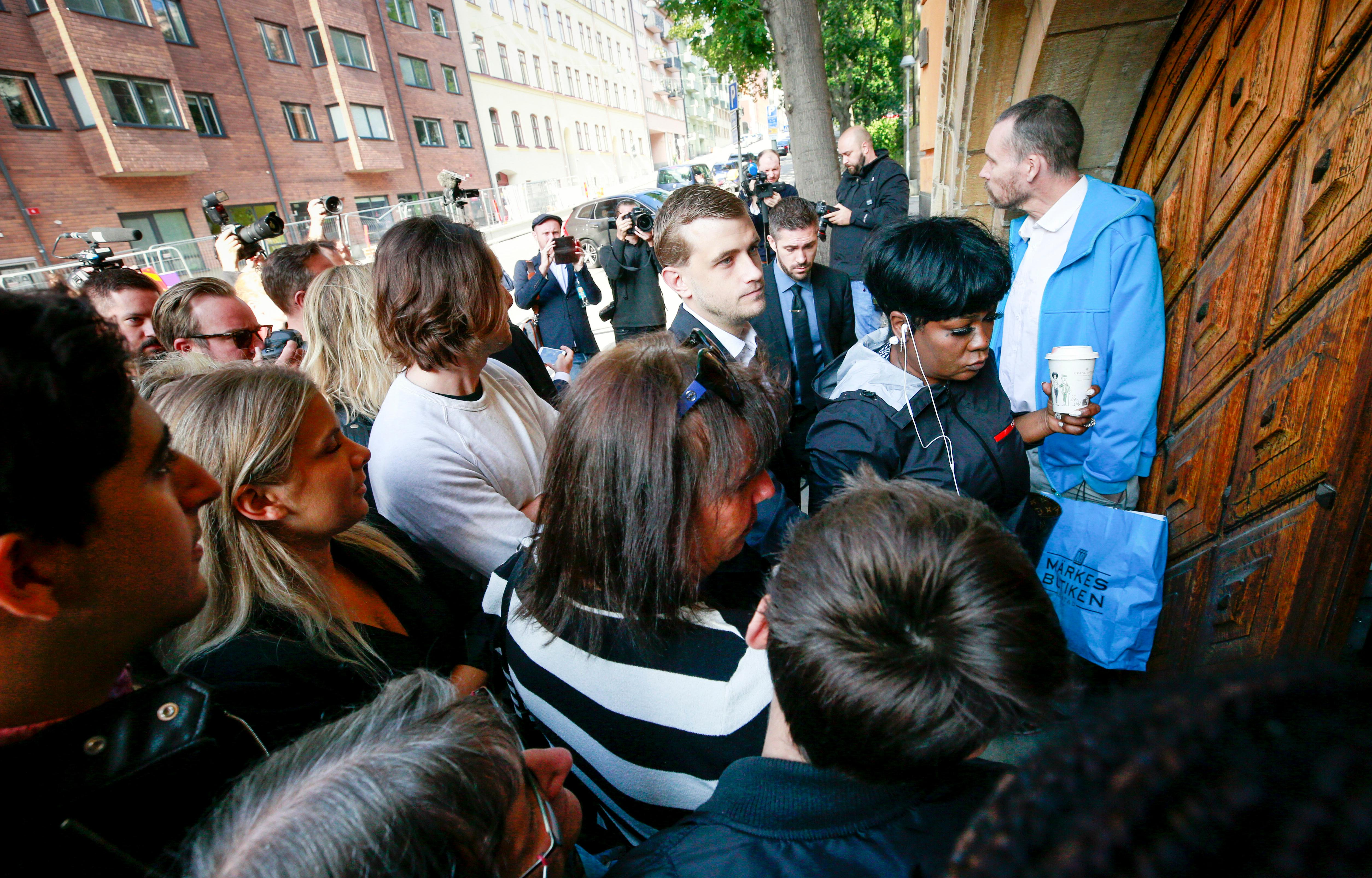 Renee Black, mother of ASAP Rocky, right, arrives at the district court in Stockholm, Thursday Aug. 1, 2019. American rapper A$AP Rocky pleaded not guilty to assault as his trial in Sweden opened Tuesday, a month after a street fight that landed him in jail and became a topic of U.S.-Swedish diplomacy. (Fredrik Persson/TT News Agency via AP)