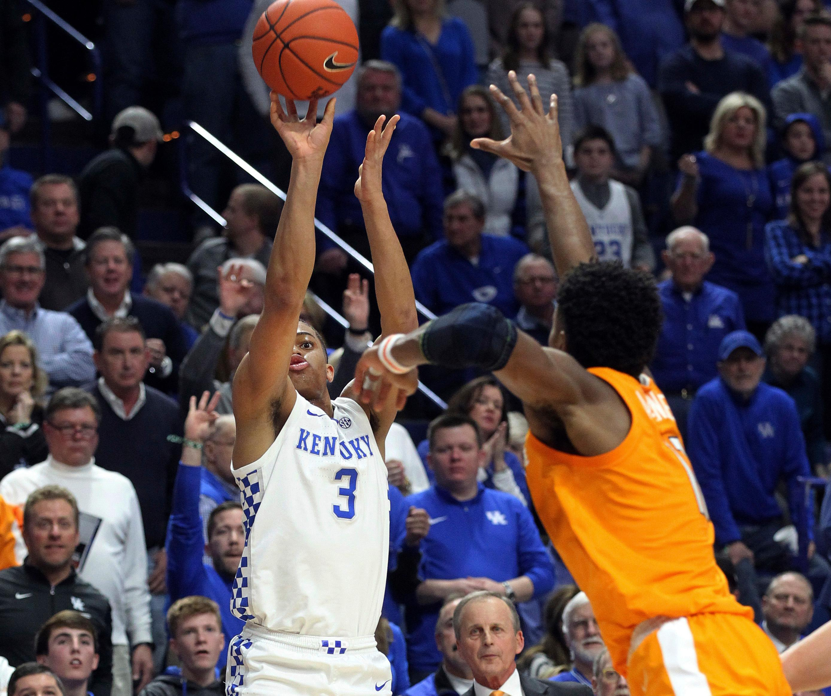 Kentucky's Keldon Johnson (3) shoots while defended by Tennessee's Kyle Alexander during the first half of an NCAA college basketball game in Lexington, Ky., Saturday, Feb. 16, 2019. (AP Photo/James Crisp)