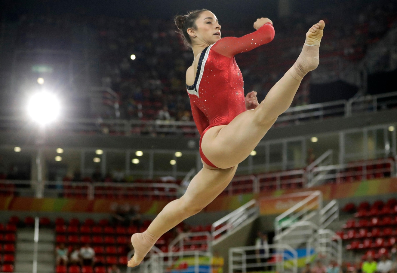 Aly Raisman of Massachusetts performs on the floor during the gymnastics exhibition gala at the 2016 Summer Olympics in Rio de Janeiro, Brazil, Wednesday, Aug. 17, 2016. (AP Photo/Dmitri Lovetsky)