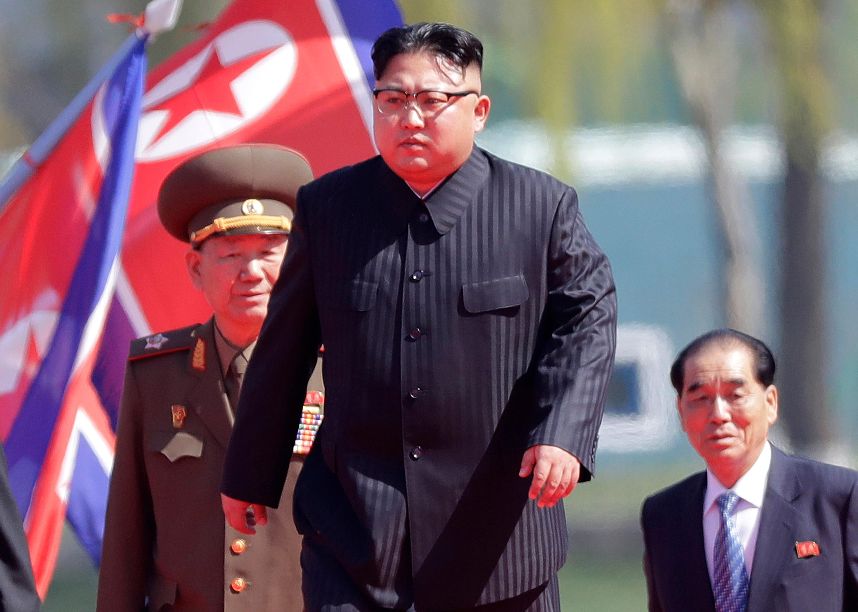FILE - In this April 13, 2017 file photo, North Korean leader Kim Jong Un, center, arrives for the official opening of the Ryomyong residential area, in Pyongyang, North Korea. South Korea's military says North Korea is believed to have conducted its sixth nuclear test. South Korea's military said Sunday, Sept. 3, 2017,  that North Korea is believed to have conducted its sixth nuclear test after it detected a strong earthquake, hours after Pyongyang claimed that its leader has inspected a hydrogen bomb meant for a new intercontinental ballistic missile. (AP Photo/Wong Maye-E, File)
