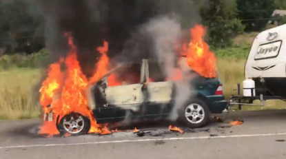Vehicle towing traveler trailer goes up in flames on I-5 | KTVL