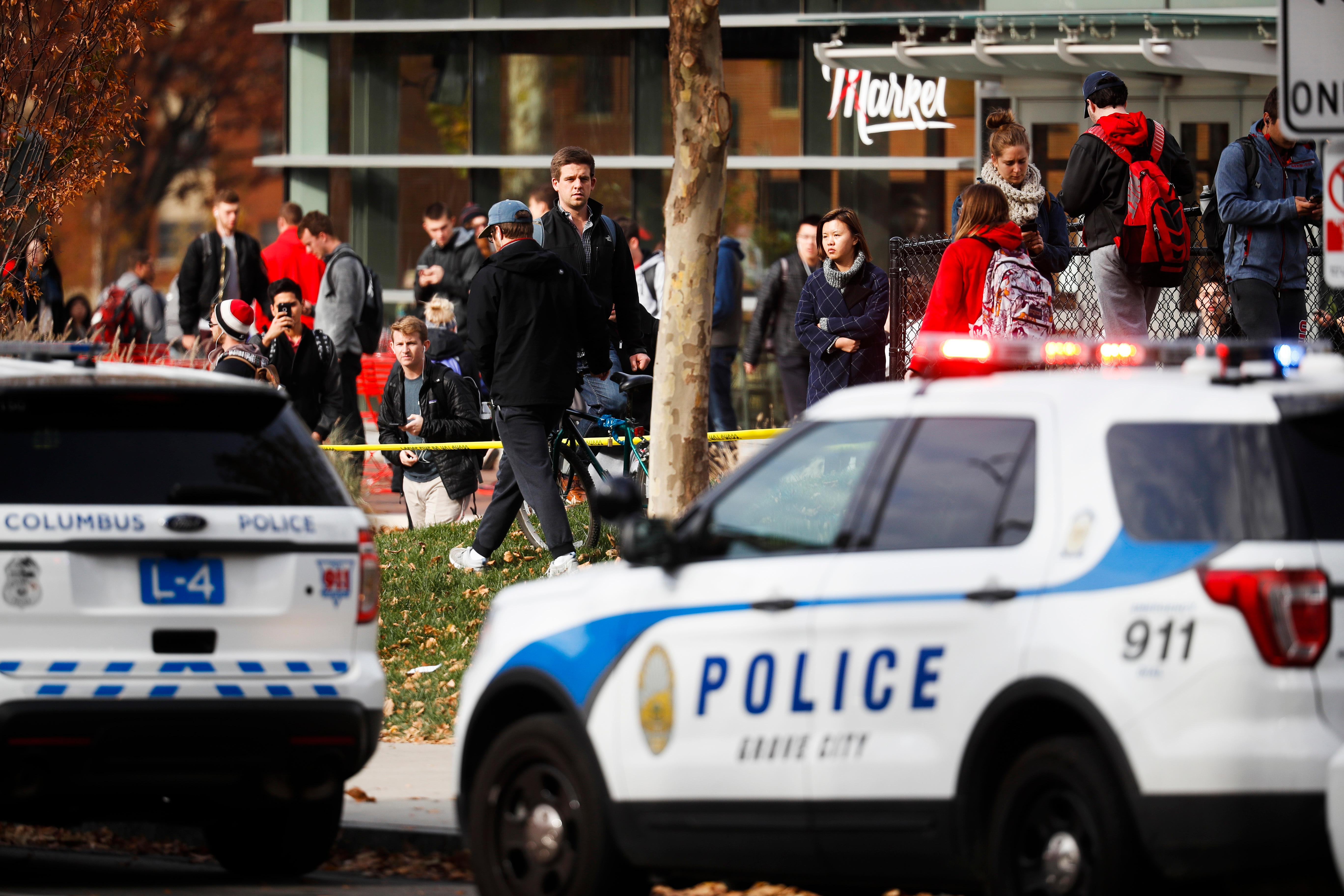 Students leave buildings surrounding Watts Hall as police respond to reports of an attack on campus at Ohio State University, Monday, Nov. 28, 2016, in Columbus, Ohio. (AP Photo/John Minchillo)<p></p>