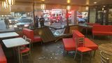 Stolen taxi slams into Macon Hardee's