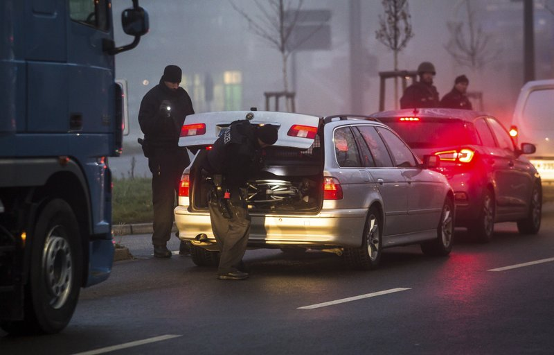 Police control the border between Germany and France in Kehl, southern Germany, Wednesday, Dec. 12, 2018, the morning after a suspected extremist sprayed gunfire at one of Europe's most famous Christmas markets in the eastern city of Strasbourg, killing three and wounding at least 13. (Christoph Schmidt/dpa via AP){&nbsp;}<p></p>