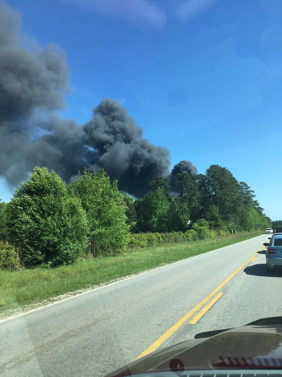 Crews battling junkyard fire in North Columbia (Photo Courtesy: Olly Otter)<p></p>