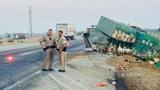 Big rig carrying turkeys overturns on Highway 99