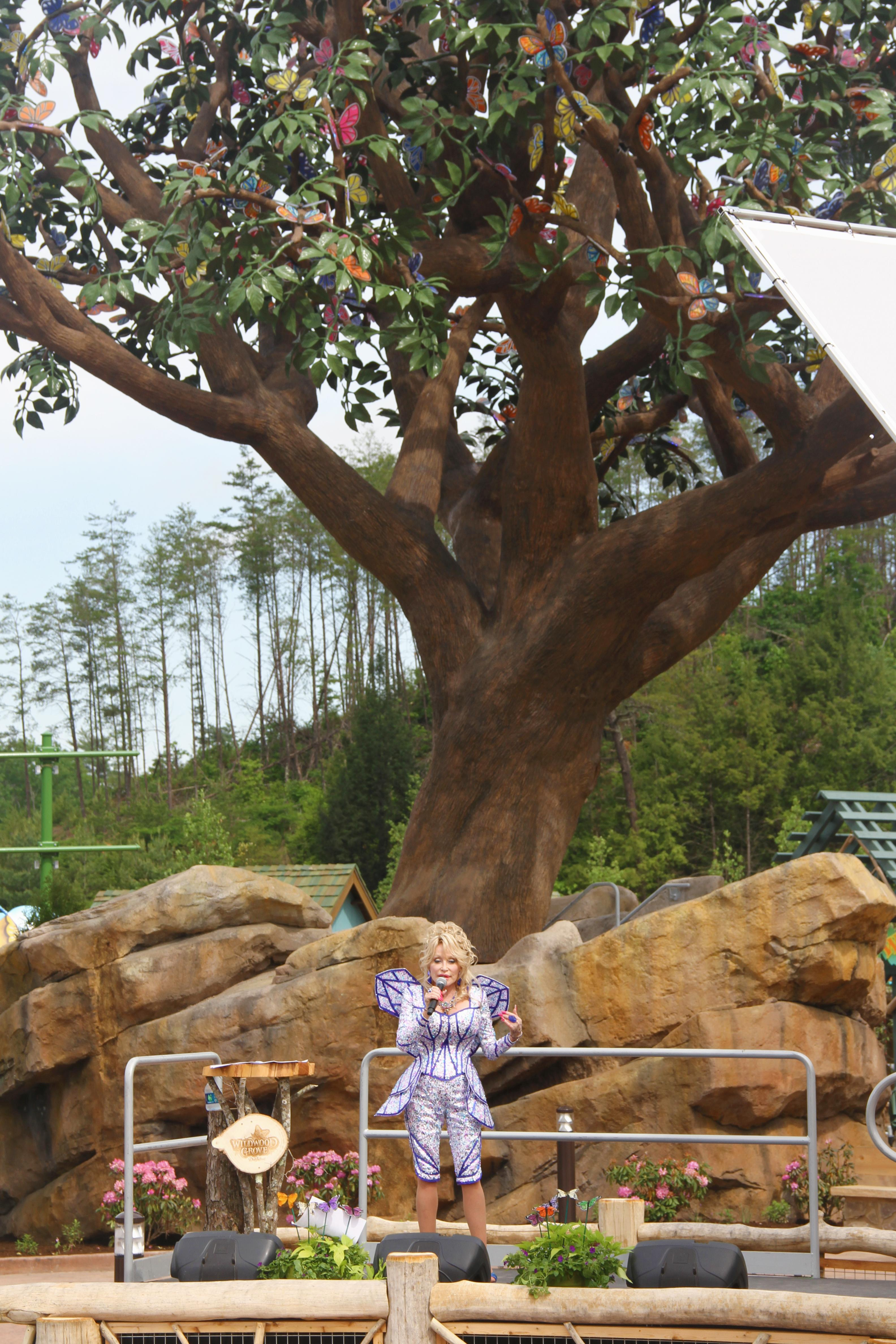 Dolly Parton celebrates the opening of Dollywood's latest expansion -- Wildwood Grove. (Photo credit: WLOS Staff)