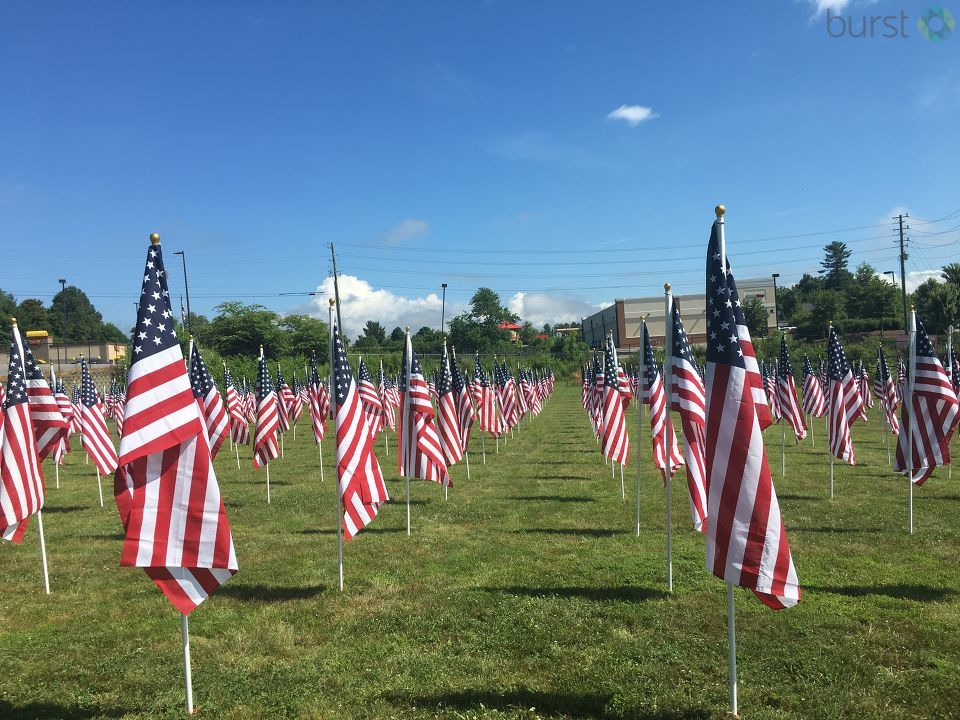 Hundreds of American flags are set up in Weaverville for what's known as the Field of Honor. The fundraiser for North Buncombe's Blackhawk Band celebrates service and patriotism. (Photo credit: WLOS staff)