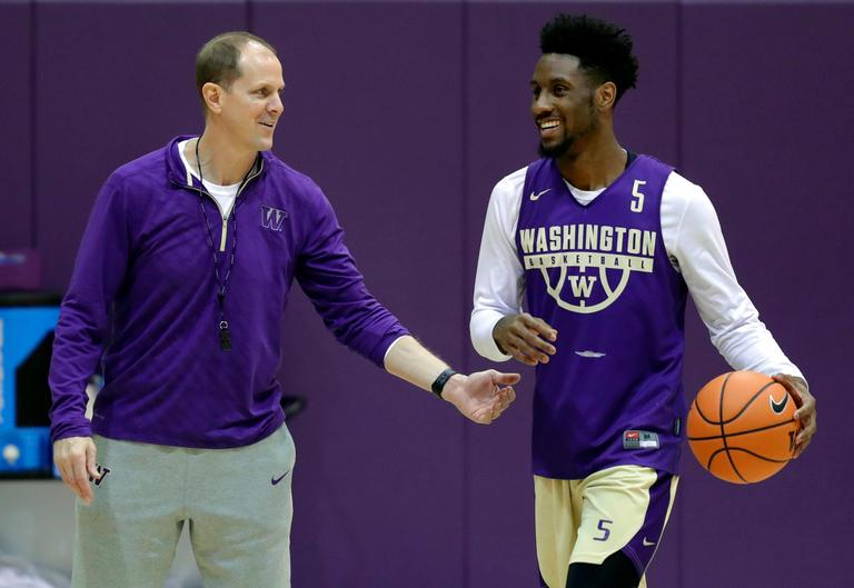 In this Friday, Jan. 26, 2018 photo, Washington head coach Mike Hopkins, left, talks with guard Jaylen Nowell during NCAA college basketball practice in Seattle. One of the most surprising stories in college basketball is what Hopkins is doing in his first season at Washington and how the Huskies are in the conversation for an NCAA bid entering February. (AP Photo/Ted S. Warren)