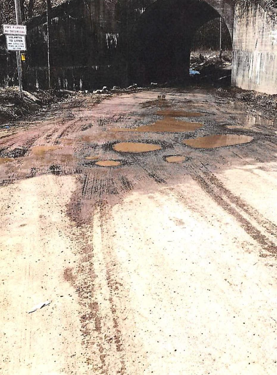 Potholes present an obstacle course at the mouth of Rush Creek. (Kanawha County Commission)