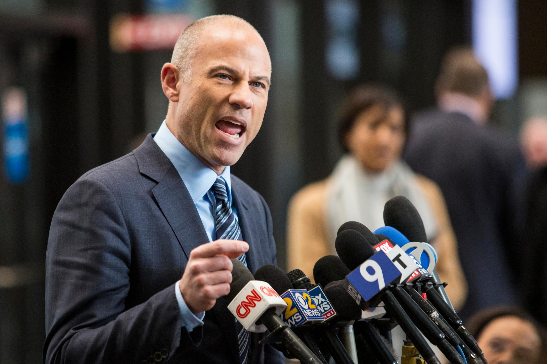 Attorney Michael Avenatti, who is representing an alleged R. Kelly victim, speaks to reporters at the Leighton Criminal Courthouse in Chicago after the R&B singer entered a not guilty plea to all 10 counts of aggravated criminal sexual abuse, Monday morning, Feb. 25, 2019. (Ashlee Rezin/Chicago Sun-Times via AP)