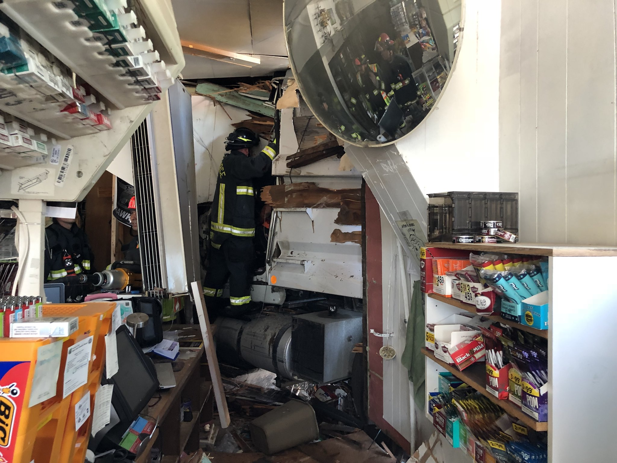 Dump truck crashes into Orting store. (Photo: East Pierce Fire)