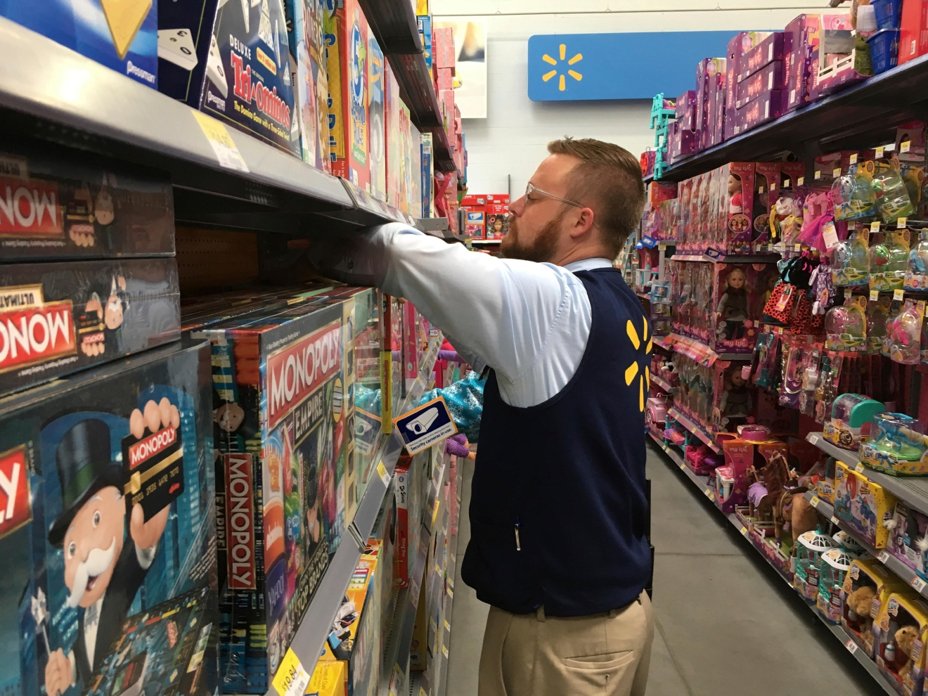 Denver Wal-Mart Supercenter employee Aaron Sanford stocks toys on shelves, Wednesday, Nov. 23, 2016, to prepare for a Thanksgiving night rush that kicks off this year's Black Friday weekend. Sanford and his colleagues anticipate hundreds will line up Thursday and thousands will come through the doors on Friday in search of bargains on toys and electronics. (AP Photo/Jim Anderson)