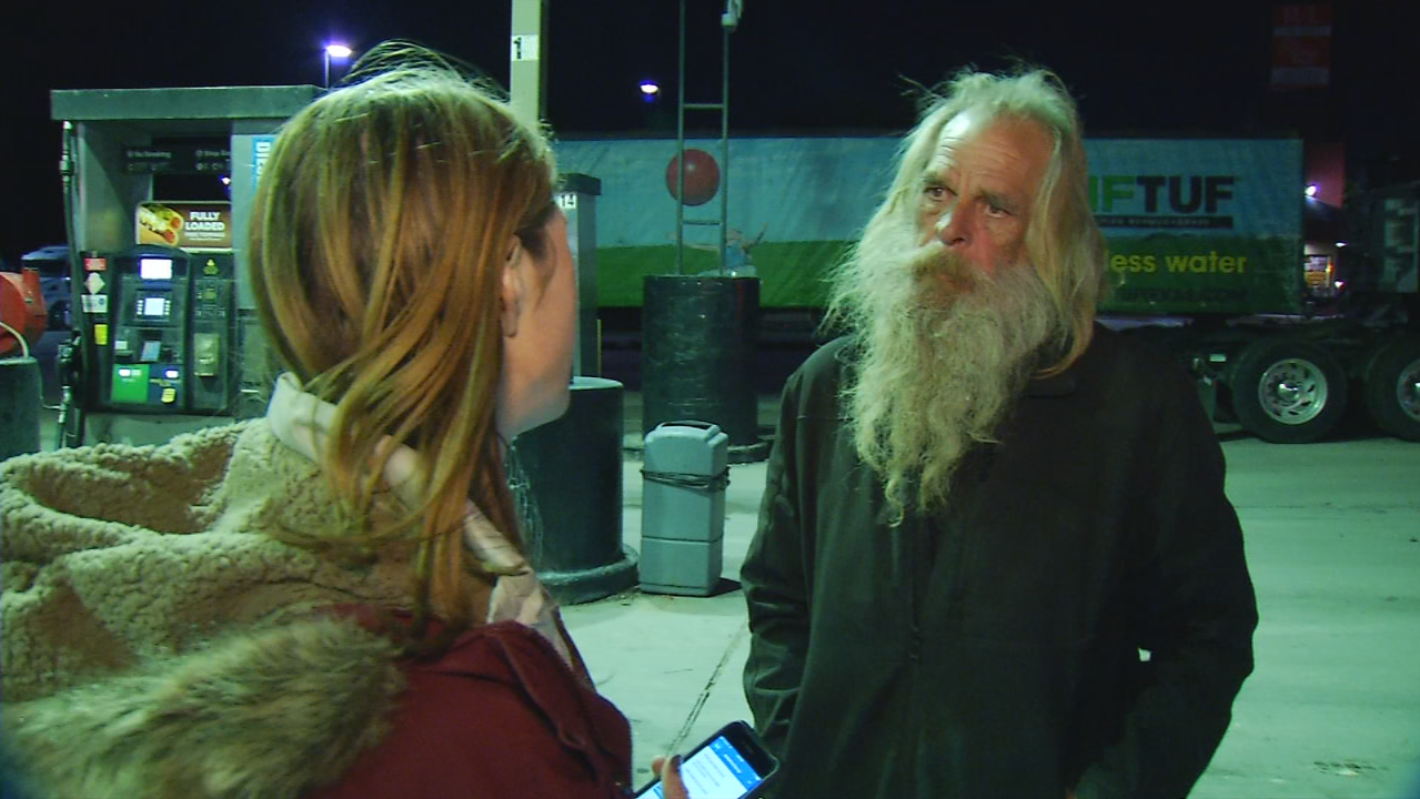 Kathleen Herrera, a social worker with the Veterans Administration, speaks with an unidentified homeless man during the Point in Time count.