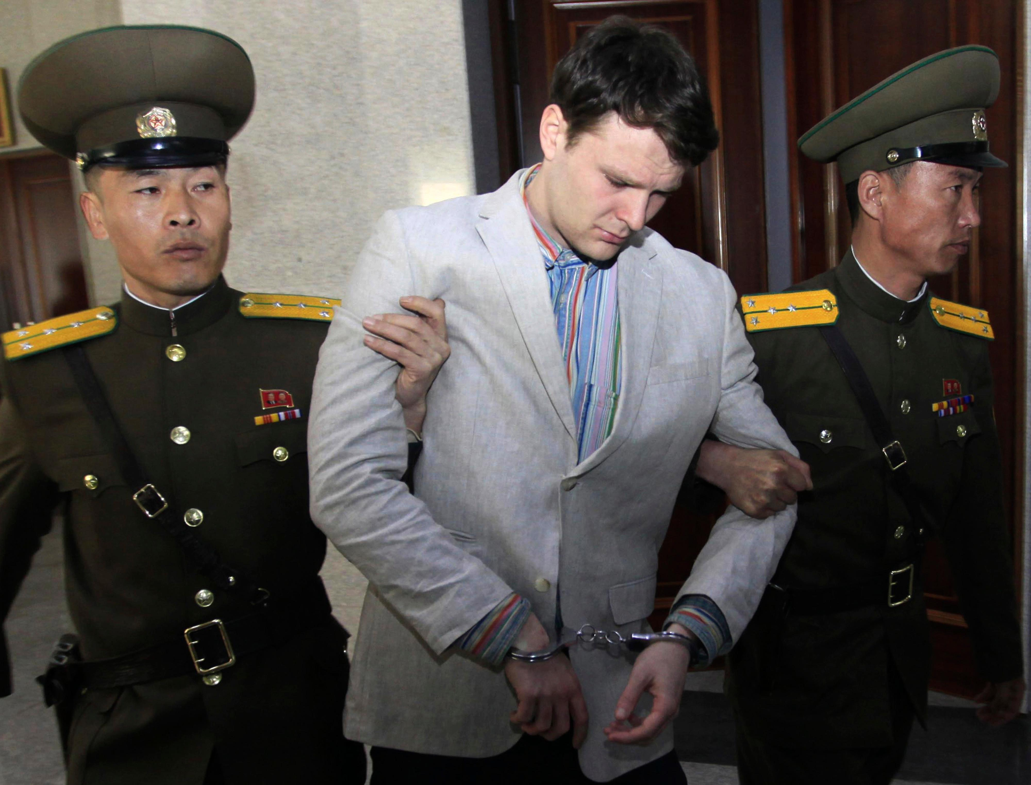 FILE - In this March 16, 2016, file photo, American student Otto Warmbier, center, is escorted at the Supreme Court in Pyongyang, North Korea. (AP Photo/Jon Chol Jin, File)