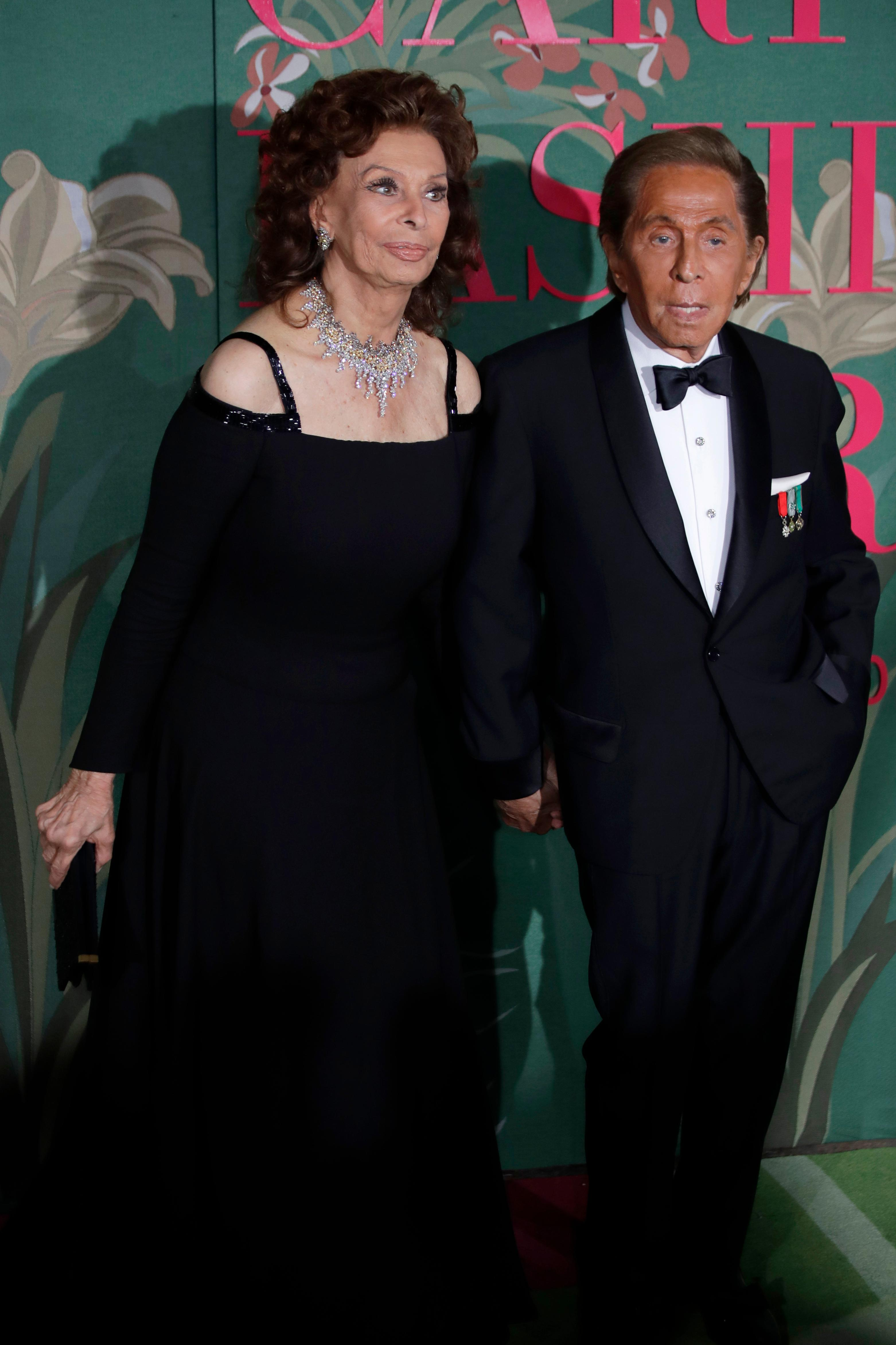 Designer Valentino Garavani, right, and actress Sophia Loren pose for photographers upon arrival at the Green Carpet Fashion Awards in Milan, Italy, Sunday, Sept. 22, 2019. (AP Photo/Luca Bruno)