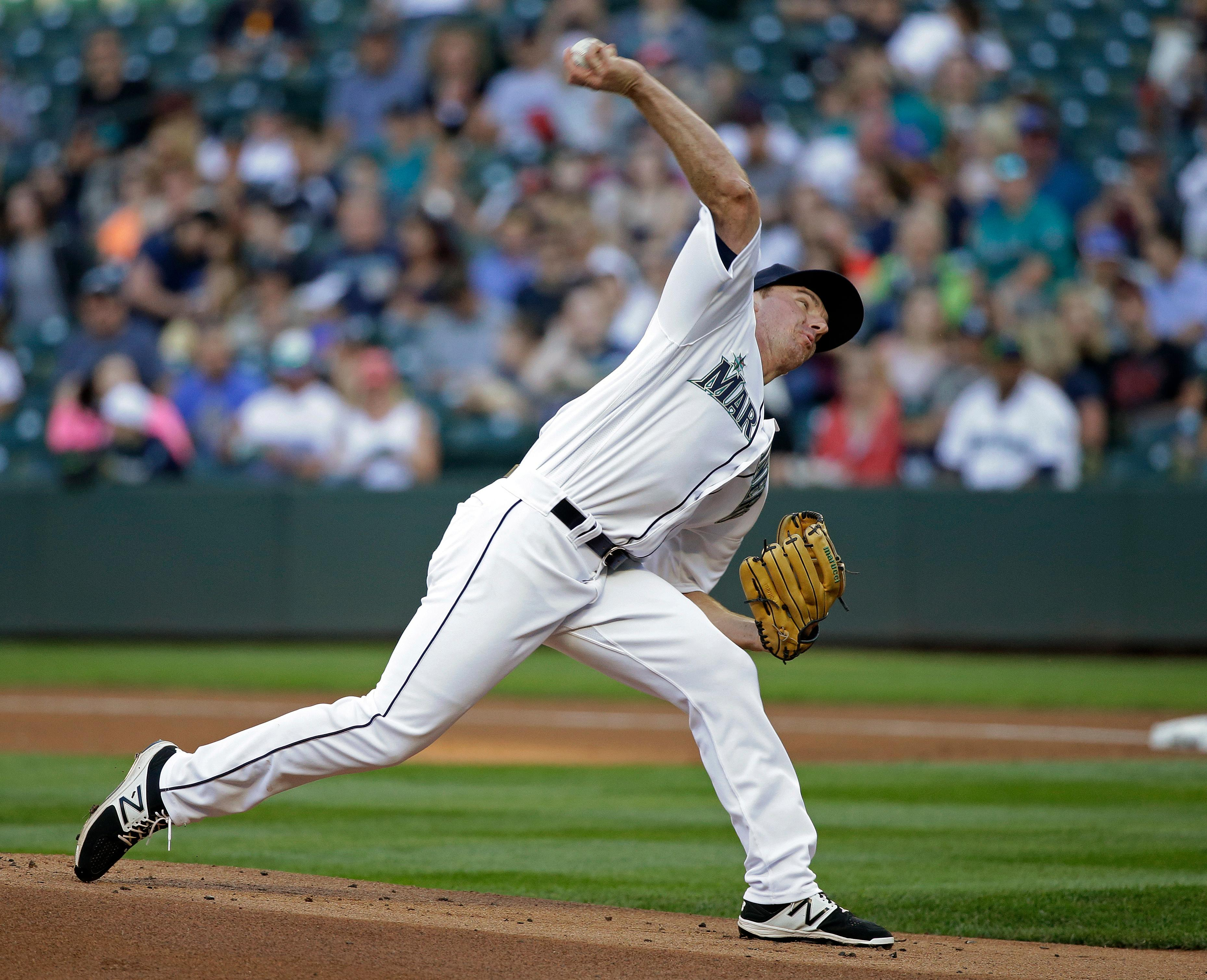 Seattle Mariners starting pitcher Andrew Moore throws his first pitch in the majors, against the Detroit Tigers in the first inning of a baseball game Thursday, June 22, 2017, in Seattle. (AP Photo/Elaine Thompson)