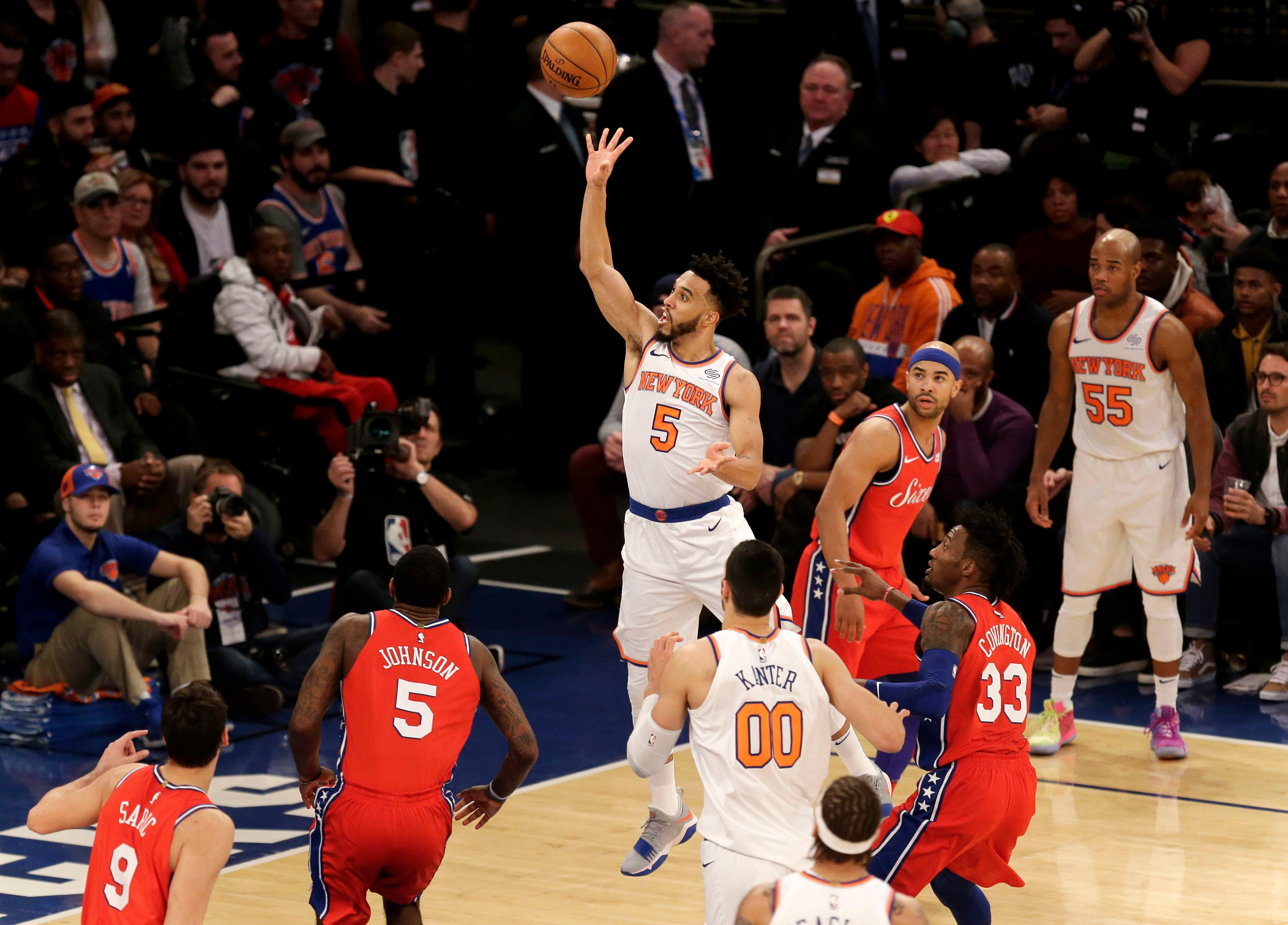 New York Knicks' Courtney Lee, center, puts up a shot during the first half of the NBA basketball game against the Philadelphia 76ers, Monday, Dec. 25, 2017, in New York. (AP Photo/Seth Wenig)