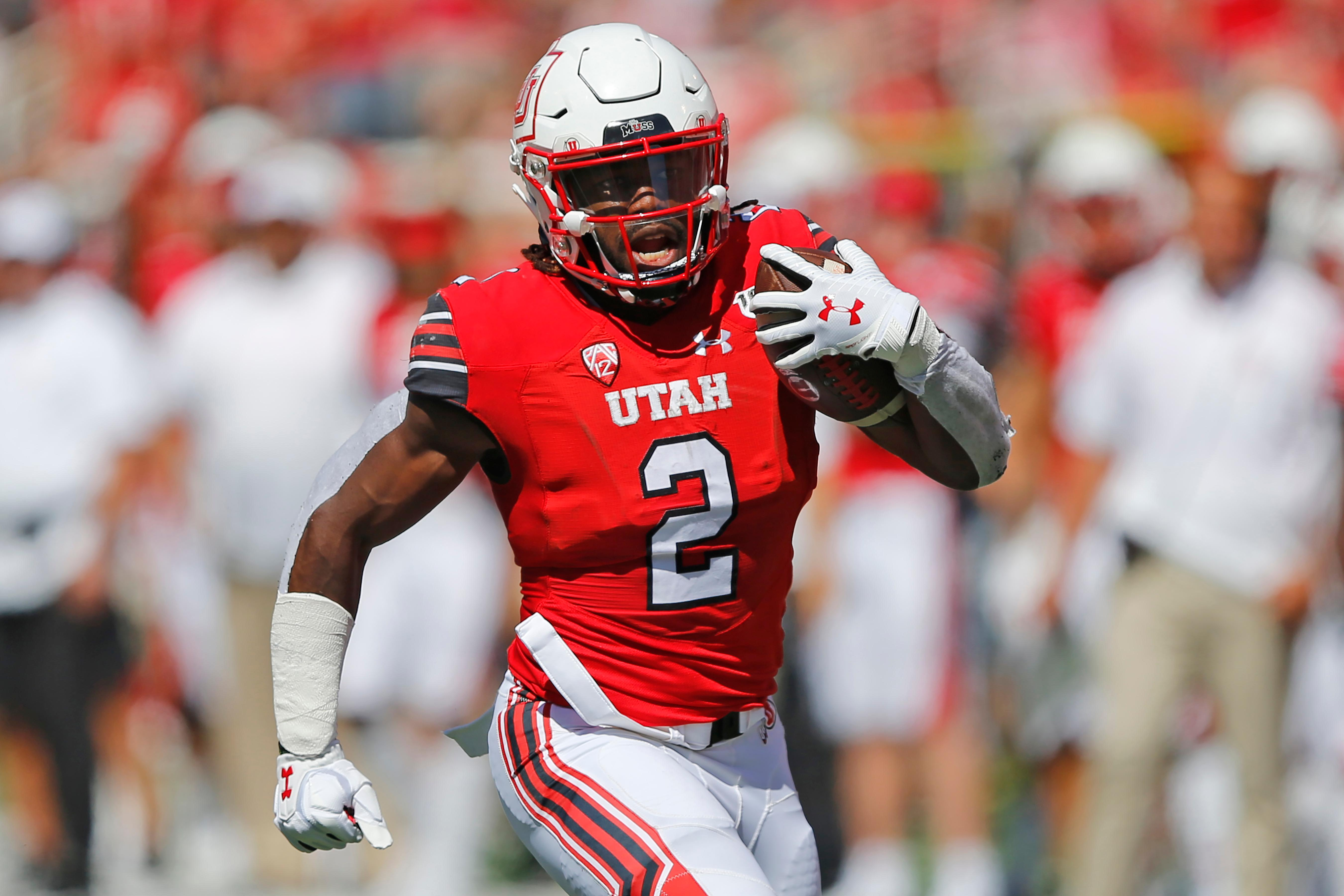 FILE - In this Sept. 14, 2019, file photo, Utah running back Zack Moss (2) carries the ball against Idaho State in the first half of an NCAA college football game, in Salt Lake City. (AP Photo/Rick Bowmer, File)